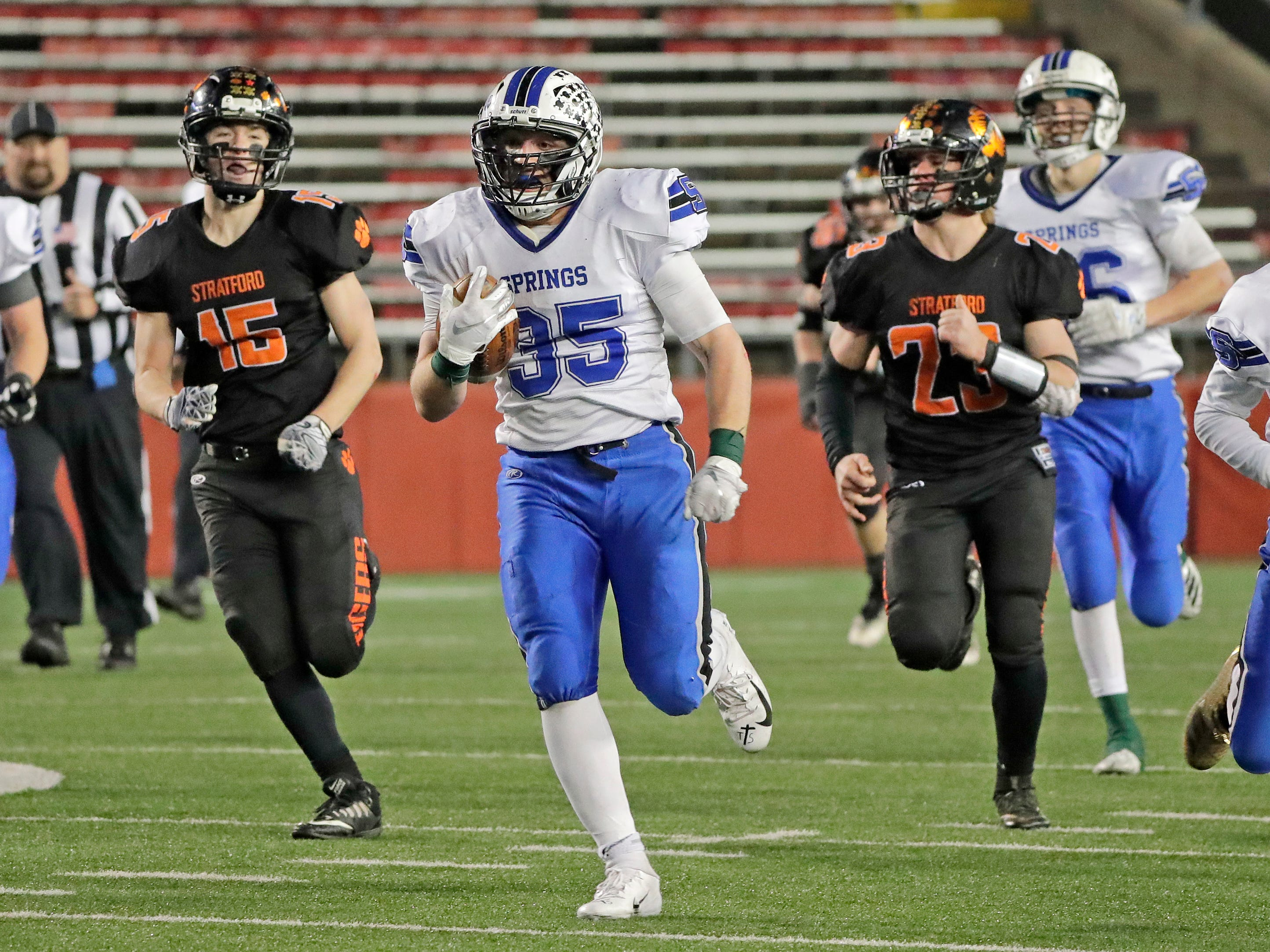 St Mary's Springs Academy's Marcus Orlandoni (35) rushes against Stratford in the WIAA Division 5 championship game at Camp Randall Stadium on Thursday, November 15, 2018 in Madison, Wis.
