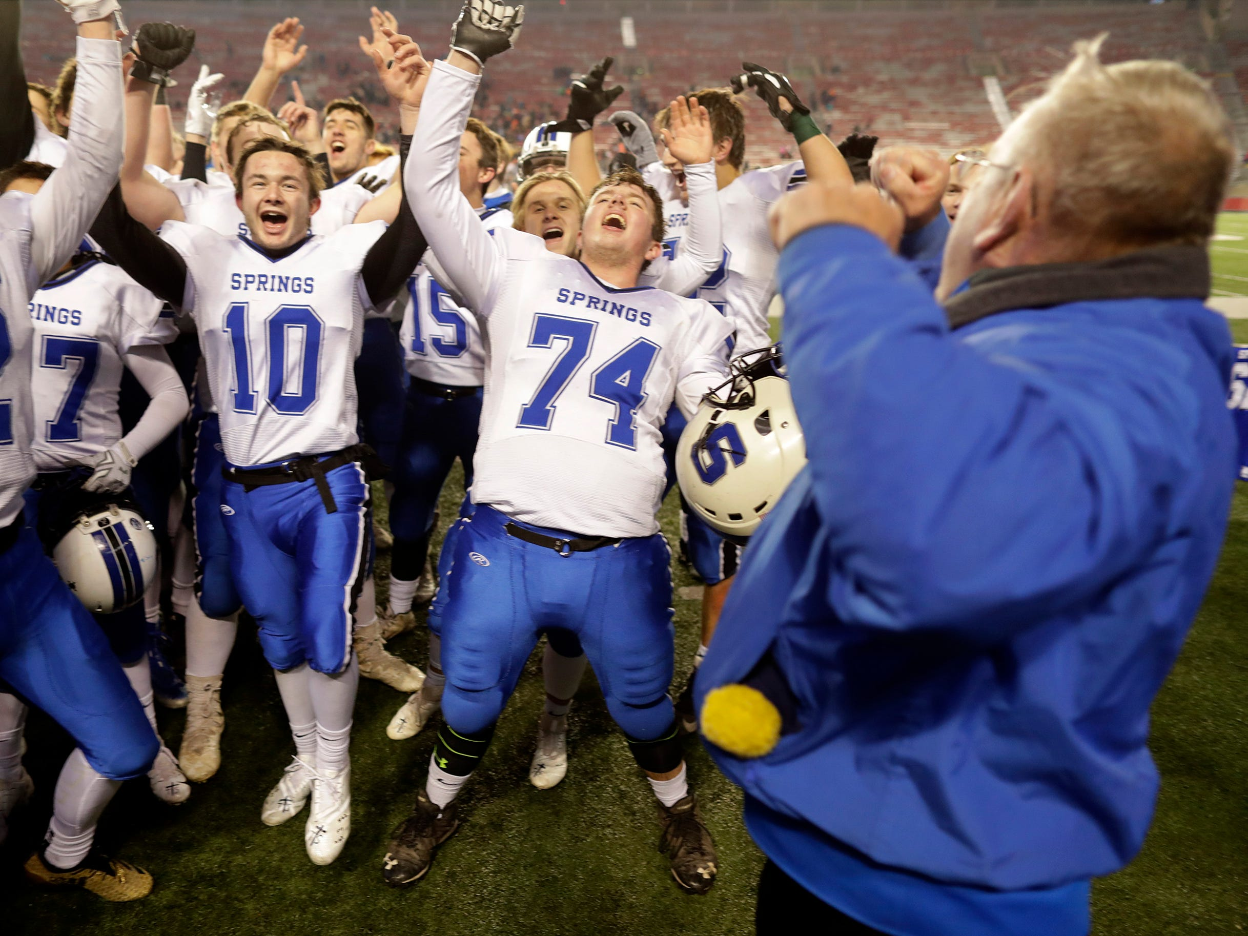 St. Mary's Springs Academy playerscelebrate the Ledgers' victory over Stratford High School during the WIAA Division  5 state championship football game on Thursday, November 15, 2018, at Camp Randall in Madison, Wis.Wm. Glasheen/USA TODAY NETWORK-Wisconsin.