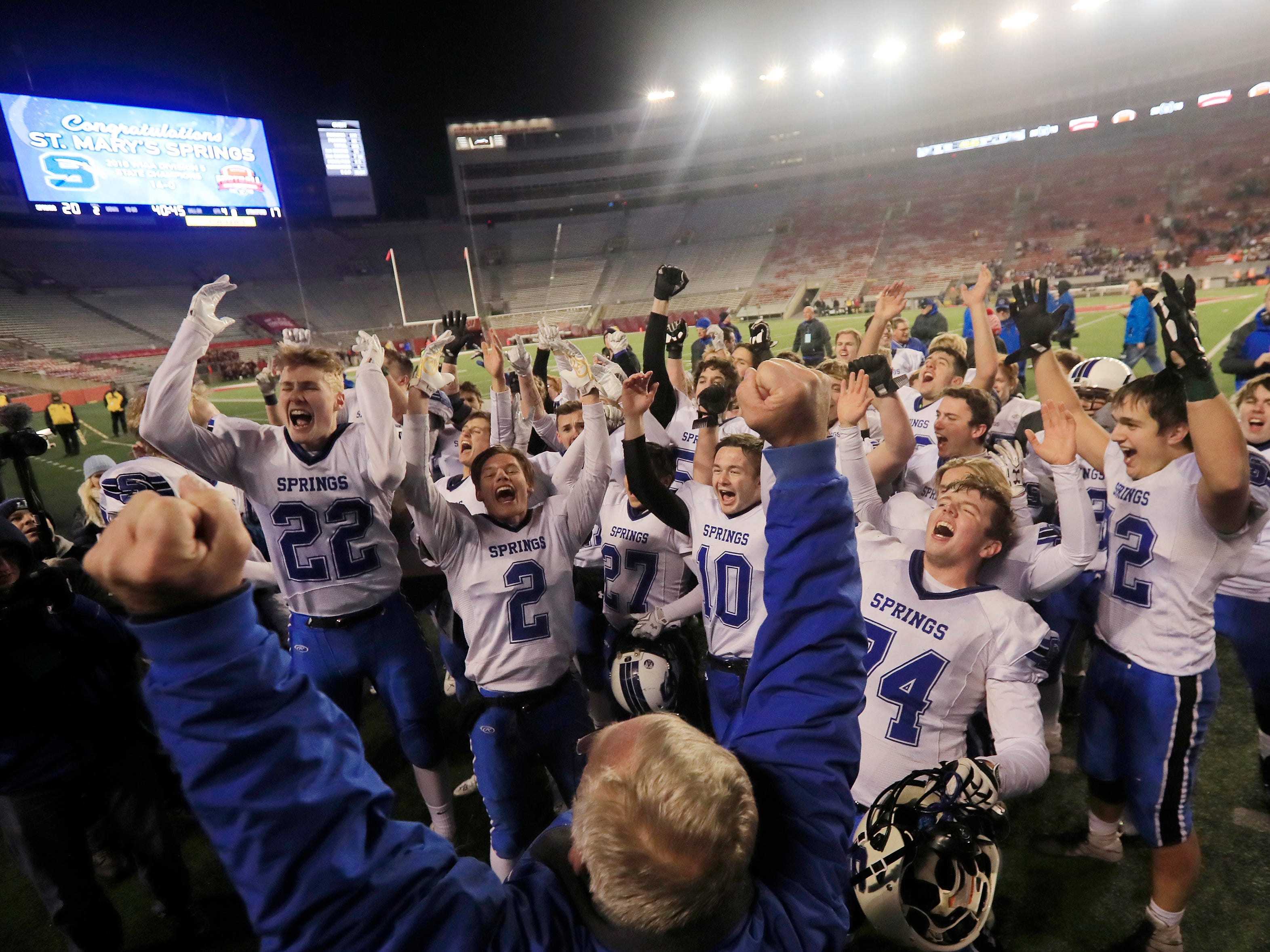 St Mary's Springs Academy players celebrate after defeating Stratford 20-17 in the WIAA Division 5 championship game at Camp Randall Stadium on Thursday, November 15, 2018 in Madison, Wis.