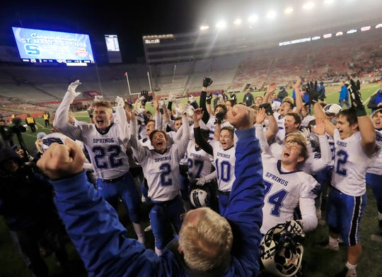 St Mary's Springs players celebrate after defeating Stratford 20-17 in the WIAA Division 5 championship game Thursday at Camp Randall Stadium in Madison.