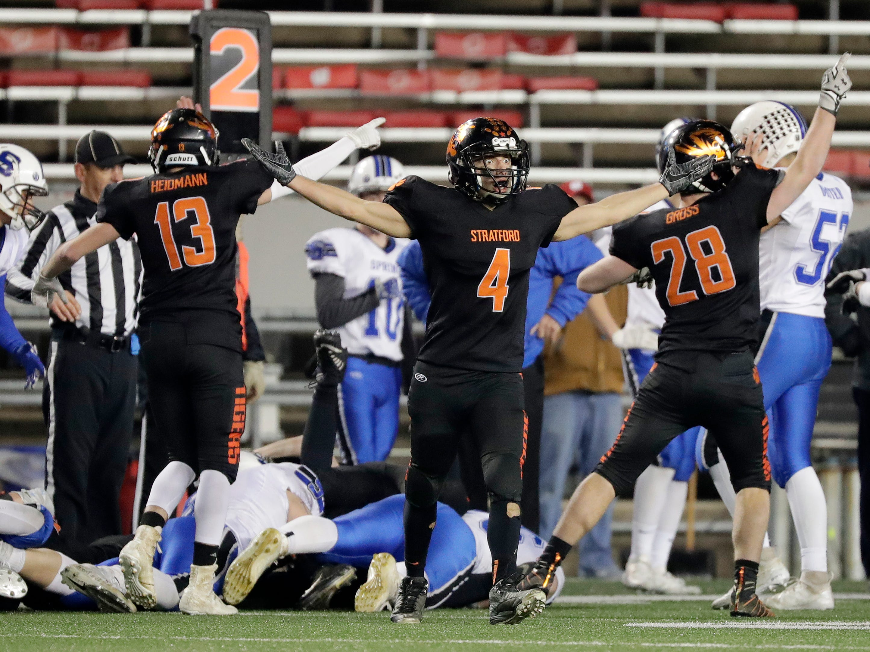 Stratford's Derek Marten (4) reacts after a St Mary's Springs Academy fumble recovered by the Tigers in the WIAA Division 5 championship game at Camp Randall Stadium on Thursday, November 15, 2018 in Madison, Wis.