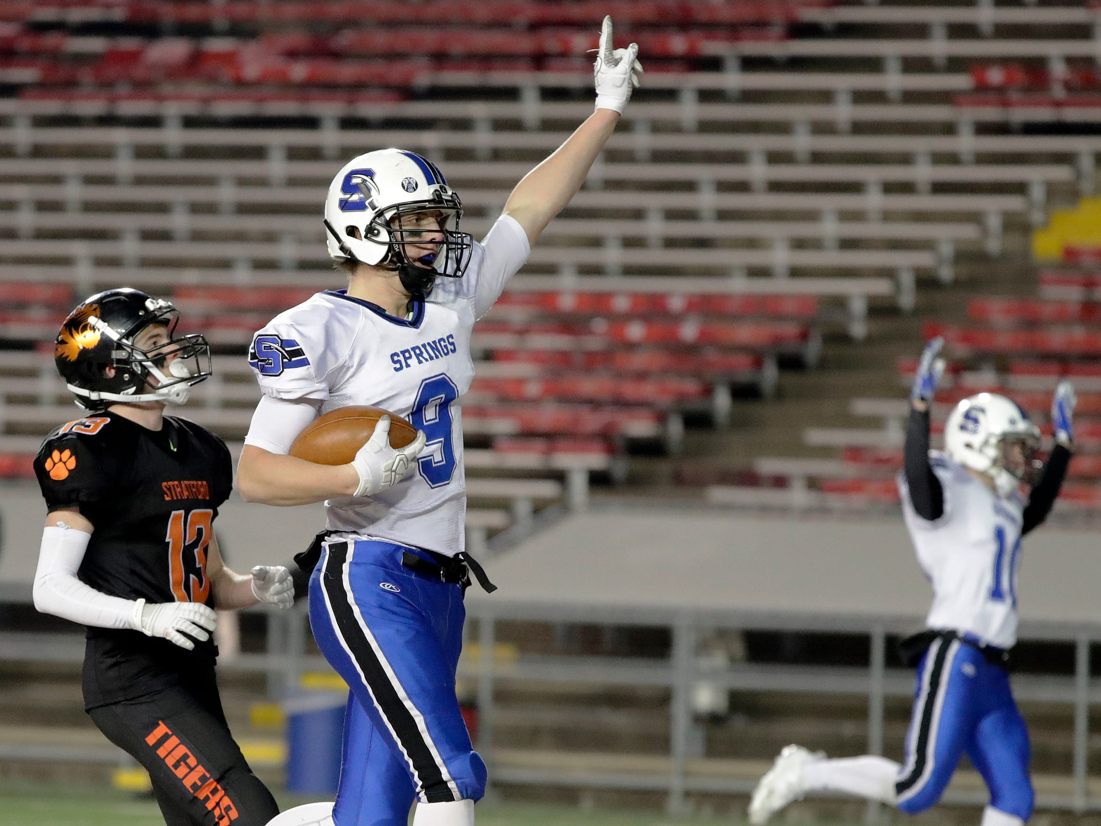 St Mary's Springs Academy's Cade Christensen (9) catches a touchdown pass against Stratford in the WIAA Division 5 championship game at Camp Randall Stadium on Thursday, November 15, 2018 in Madison, Wis.