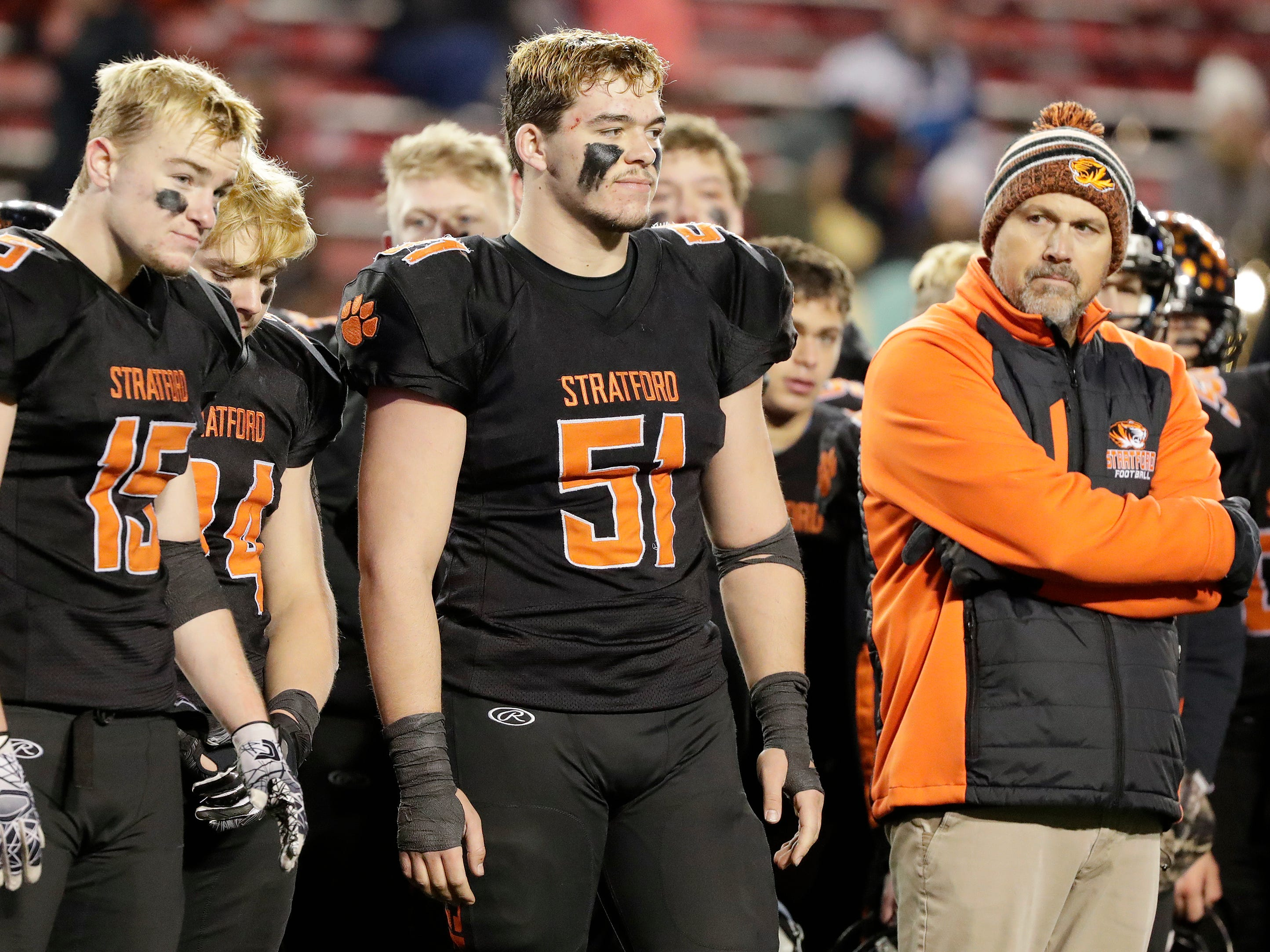 Stratford's Okley Wrensch (15) and Dylan Schoenherr (51) await their runners up awards after the Tigers lost 20-17 to St Mary's Springs Academy in the WIAA Division 5 championship game at Camp Randall Stadium on Thursday, November 15, 2018 in Madison, Wis.