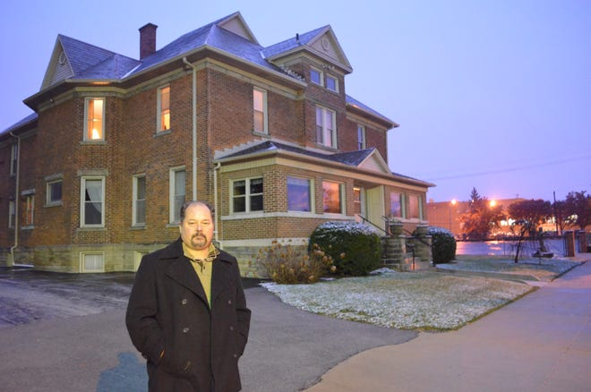 Riley Kinn stands in front of the rectory at St. Wendelin Catholic Church in Fostoria where he says he was abused as a 13-year-old boy by a priest, Joseph Schmelzer.