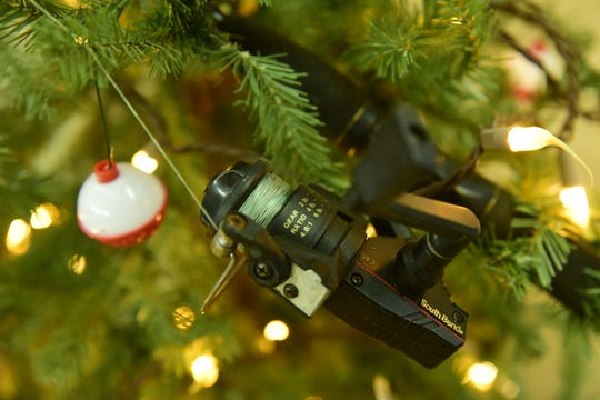 Fishing gear was among the decorations featured at Christmas Tree Lane, a display of 15 trees at St. Paul Lutheran Church during the 42nd Annual Winesburg Christmas Weekend.