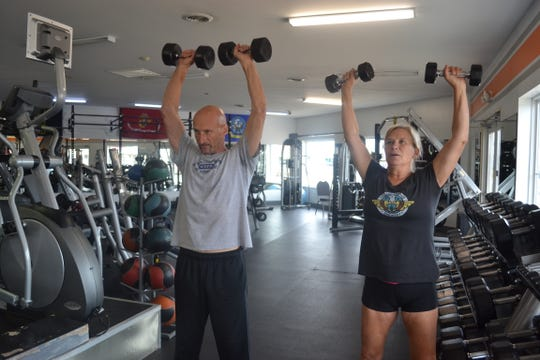 Clients lift weights at Bodi N Balance in Port Clinton. The fitness studio has a wide variety of clients of all ages and levels of health.