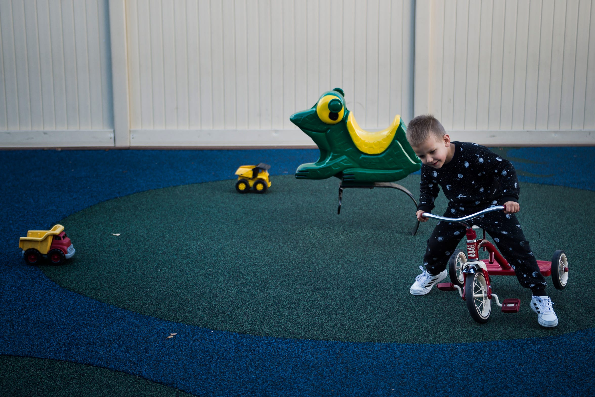 Did Barraza, 4, keeps a tricycle uprights during a recess time on Thursday, Nov. 15, 2018, at The Learning Experience child development center in Fort Collins, Colo.