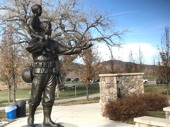 A bronze statue of a soldier showing the future to a child is a feature of Veterans Plaza of Northern Colorado.