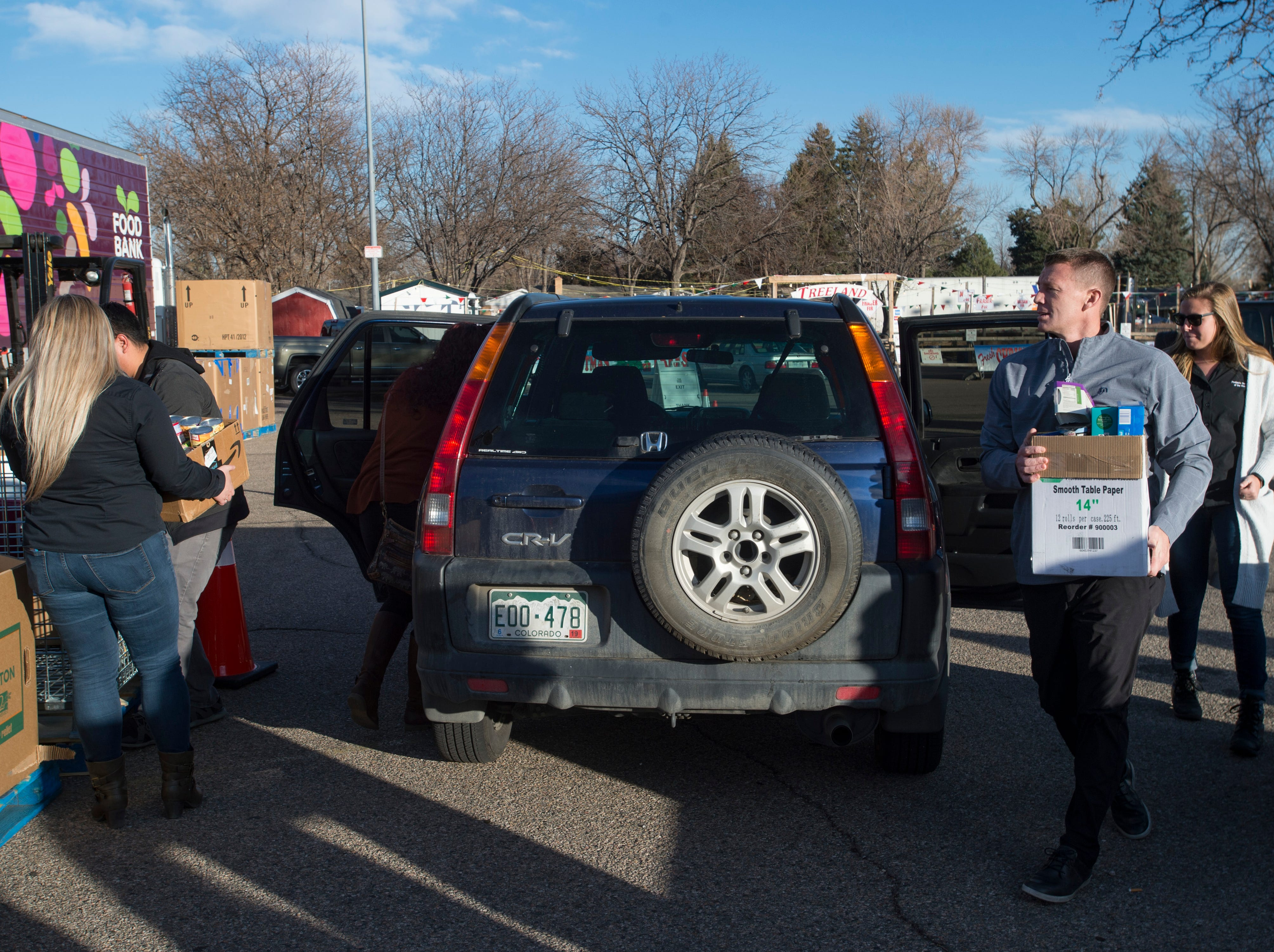 Donated Thanksgiving turkeys are collected during the Food Bank for Larimer County's Stuff The Truck Turkey Donation on Thursday, November 15, 2018.