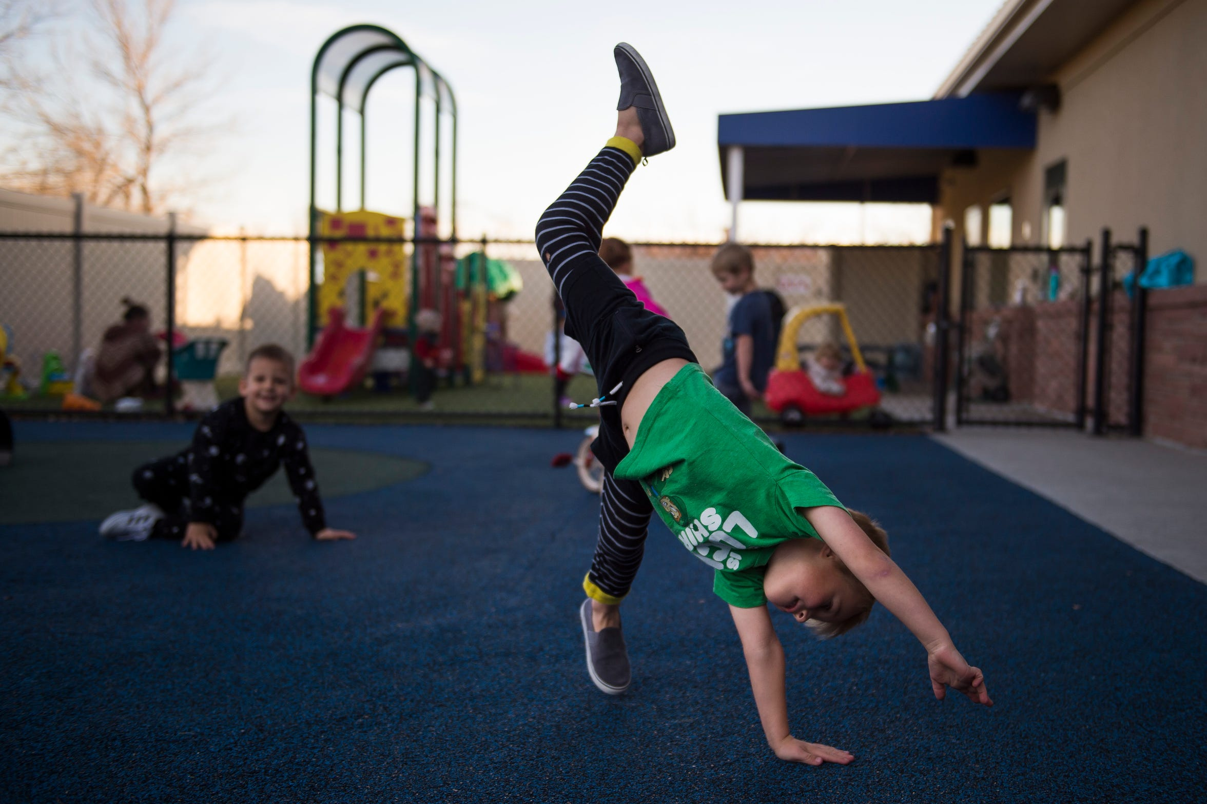 Sawyer Whitlock, 4, does a cartwheel during a recess time on Thursday, Nov. 15, 2018, at The Learning Experience child development center in Fort Collins, Colo.