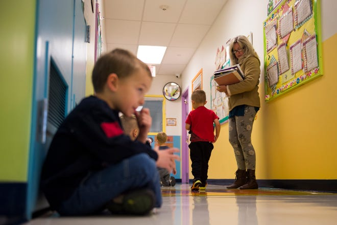 Pre-K teacher Missy Thompson calls out children's names one by one to direct them to their classroom on Thursday, Nov. 15, 2018, at The Learning Experience child development center in Fort Collins, Colo.