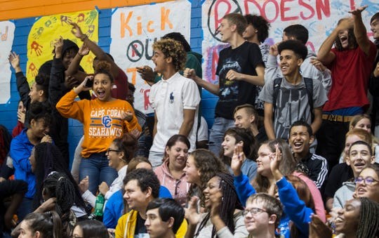 Cape Coral High School students react and celebrate after a 3-pointer during a Unified Sports basketball game against Mariner High School on Friday, Nov. 16, 2018.