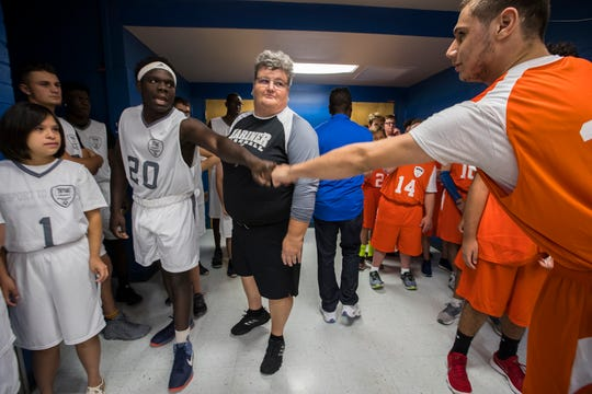 Mariner's Victor Wright, left, and Cape Coral's Luis Duran pump fists before their game Friday morning, Nov. 16, 2018. Cape Coral High hosted Mariner during a Unified Sports basketball game Friday, Nov. 16, 2018.
