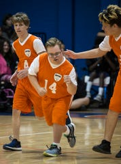 Cape Coral High School student Nathan Huffman pumps his fist after scoring during the team's Unified Sports game against Mariner High School on Friday morning, Nov. 16, 2018.