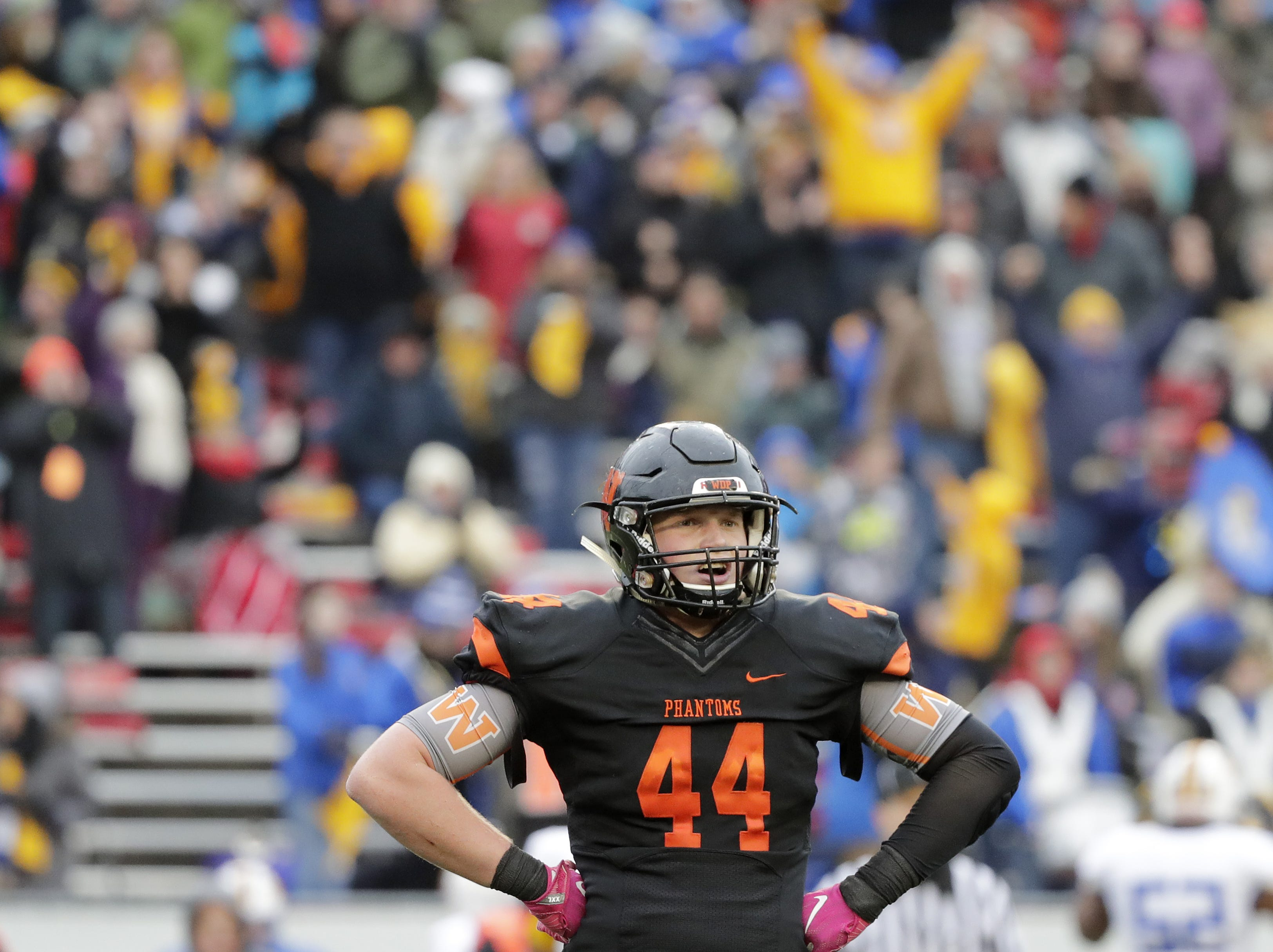 West De Pere's Jake Karchinski (44) reacts in the final minute of the Phantoms loss to Catholic Memorial in the WIAA Division 3 championship game at Camp Randall Stadium on Friday, November 16, 2018 in Madison, Wis.