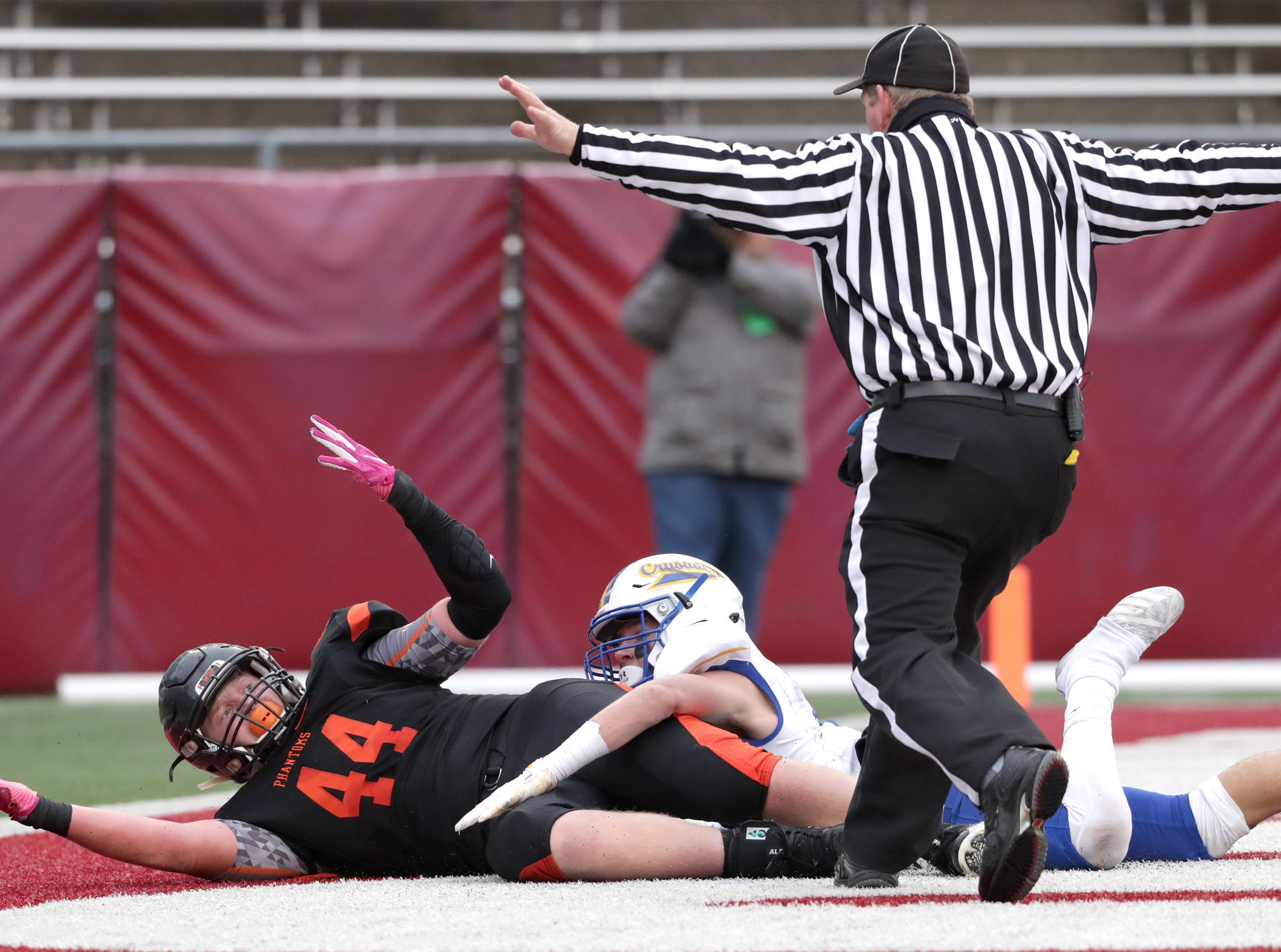 West De Pere High School's #44 Jake Karchinski looks for a pass interference cal in the end zone against Catholic Memorial High School's #10 Matthew Schultz during the WIAA Division  3 state championship football game on Friday, November 16, 2018, at Camp Randall in Madison, Wis. Wm. Glasheen/USA TODAY NETWORK-Wisconsin.