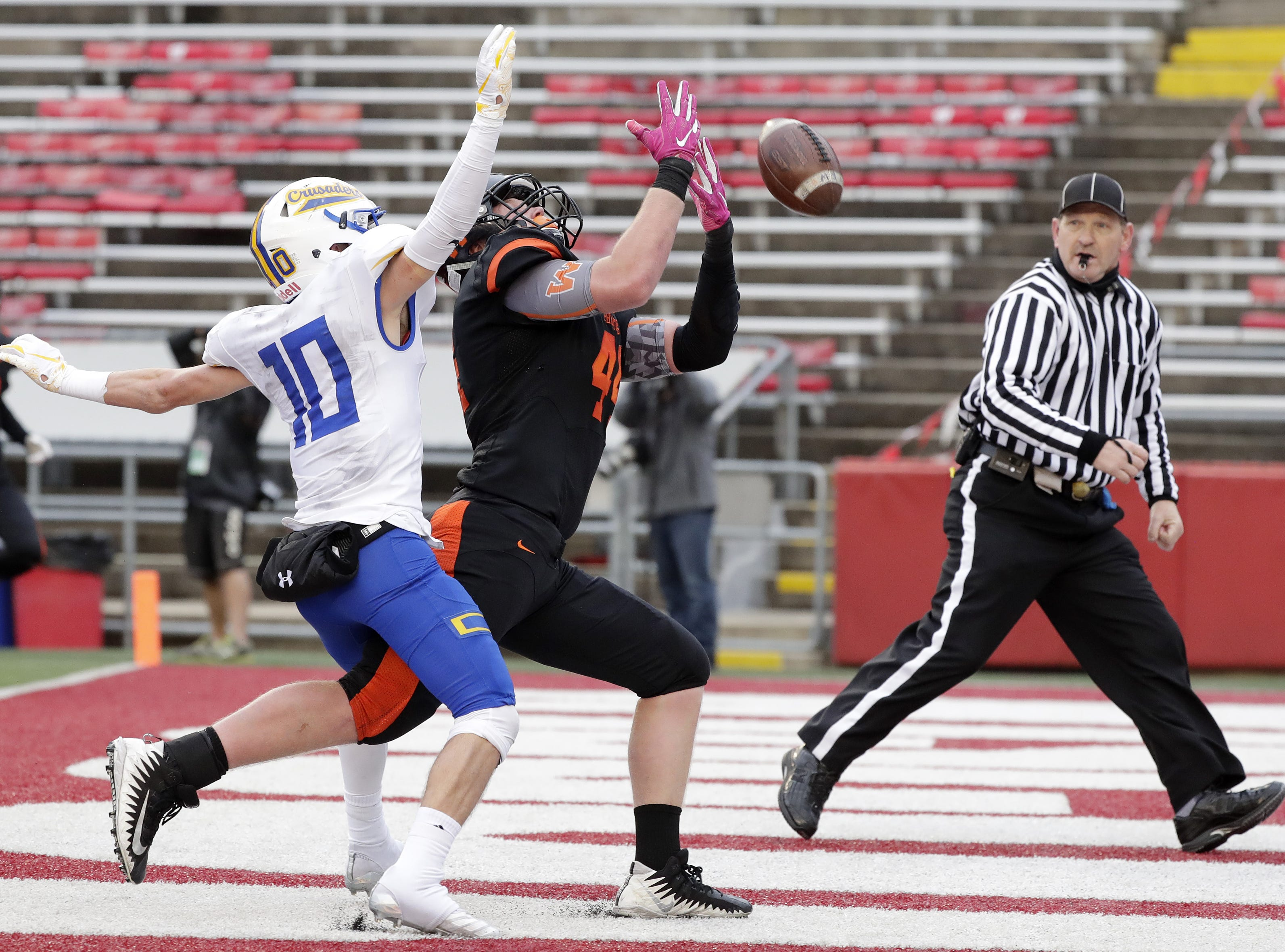 West De Pere's Jake Karchinski (44) can't come up with the ball in the end zone against Catholic Memorial's Matthew Schultz (10) in the WIAA Division 3 championship game at Camp Randall Stadium on Friday, November 16, 2018 in Madison, Wis.