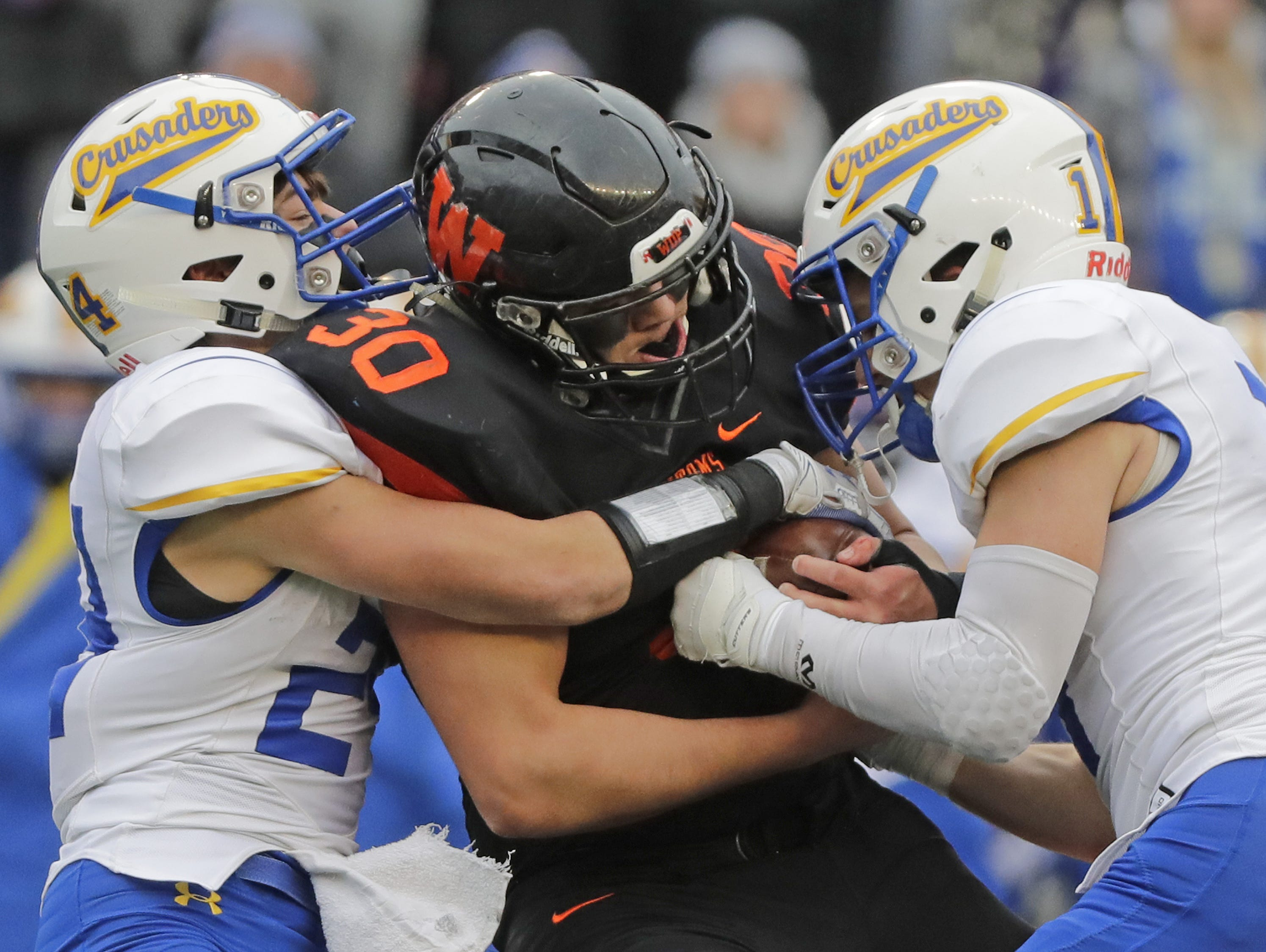 West De Pere's Cody Cavil (30) rushes against Catholic Memorial in the WIAA Division 3 championship game at Camp Randall Stadium on Friday, November 16, 2018 in Madison, Wis.