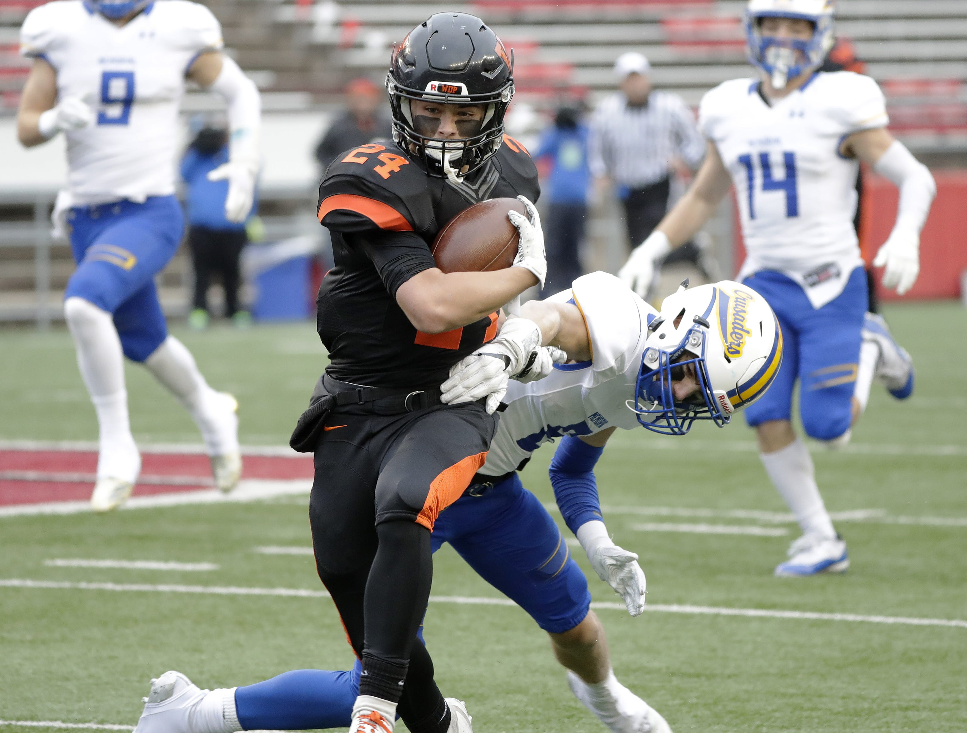 West De Pere's Sam Mommaerts (24) runs after a catch against Catholic Memorial in the WIAA Division 3 championship game at Camp Randall Stadium on Friday, November 16, 2018 in Madison, Wis.