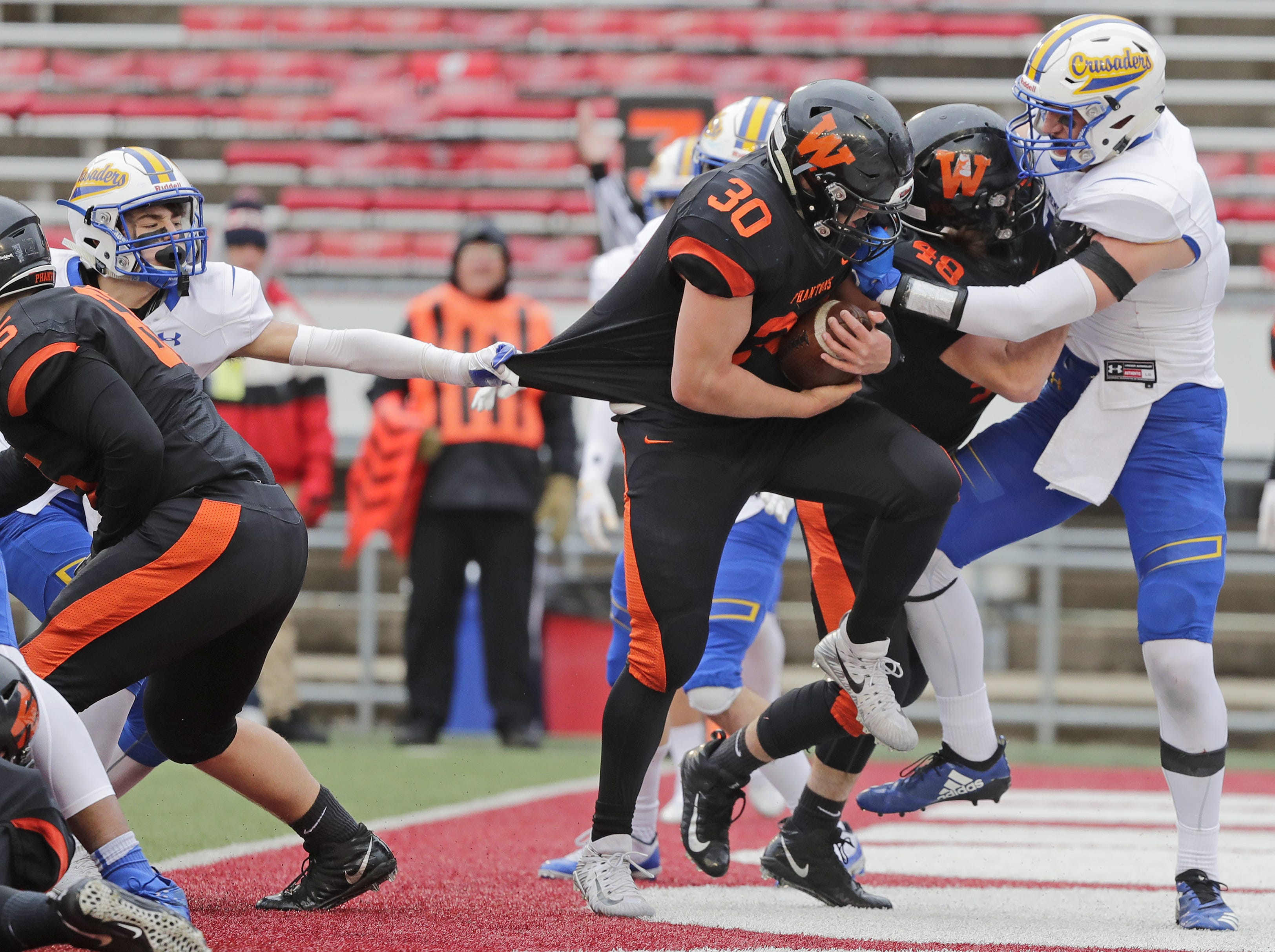West De Pere's Cody Cavil (30) rushes for a touchdown against Catholic Memorial in the WIAA Division 3 championship game at Camp Randall Stadium on Friday, November 16, 2018 in Madison, Wis.