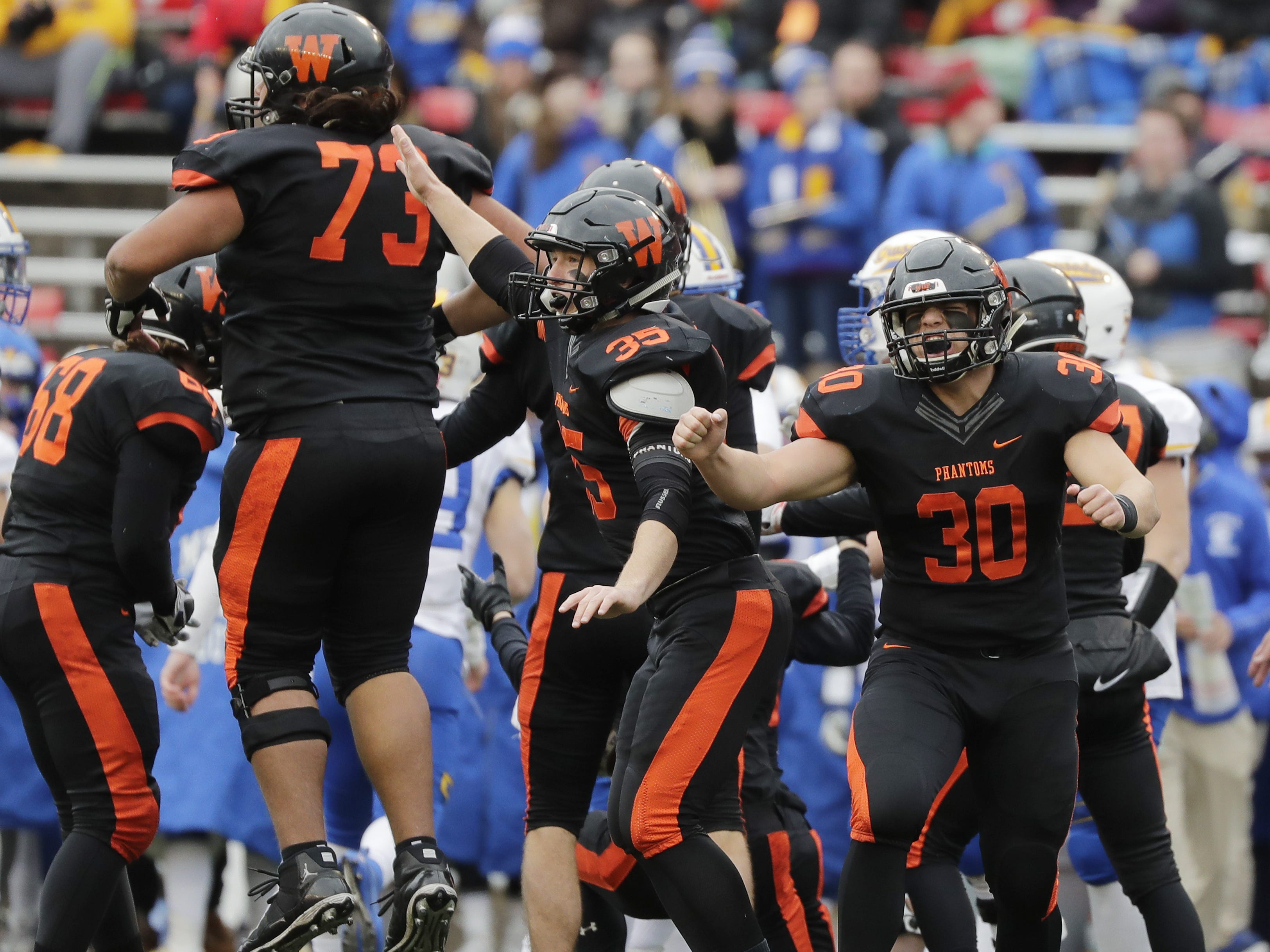 West De Pere's Cody Cavil (30) reacts as the Phantoms recovered a fumble by Catholic Memorial in the WIAA Division 3 championship game at Camp Randall Stadium on Friday, November 16, 2018 in Madison, Wis.