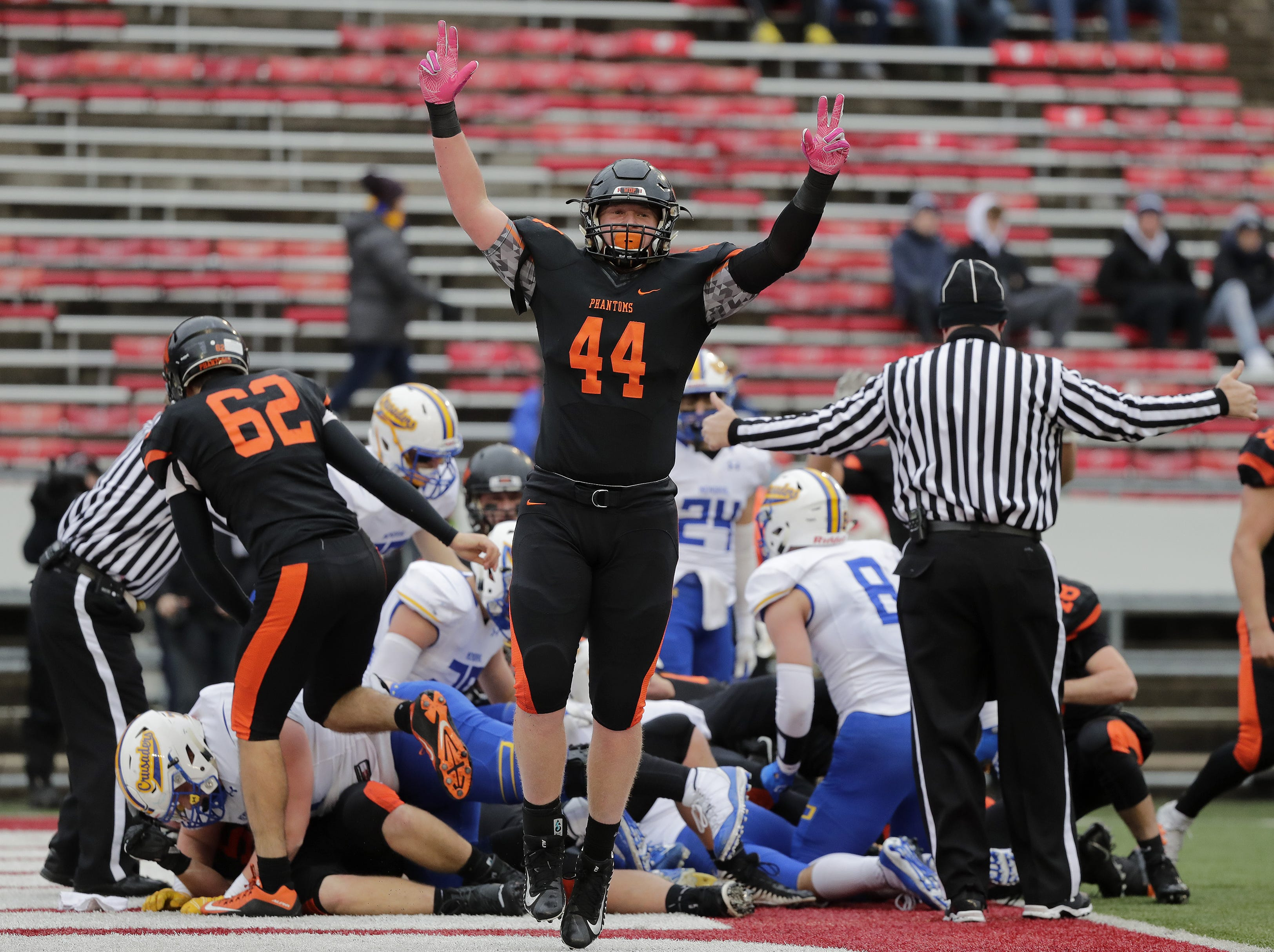West De Pere's Jake Karchinski (44) celebrates after a Phantoms touchdown against Catholic Memorial in the WIAA Division 3 championship game at Camp Randall Stadium on Friday, November 16, 2018 in Madison, Wis.