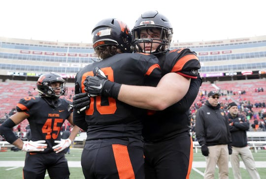 West De Pere's Owyn Newman, left, and Liam McDonough embrace after the Phantoms' loss to Catholic Memorial High School in the WIAA Division 3 state championship football game in November. McDonough signed a letter of intent Tuesday to play at Michigan Tech.