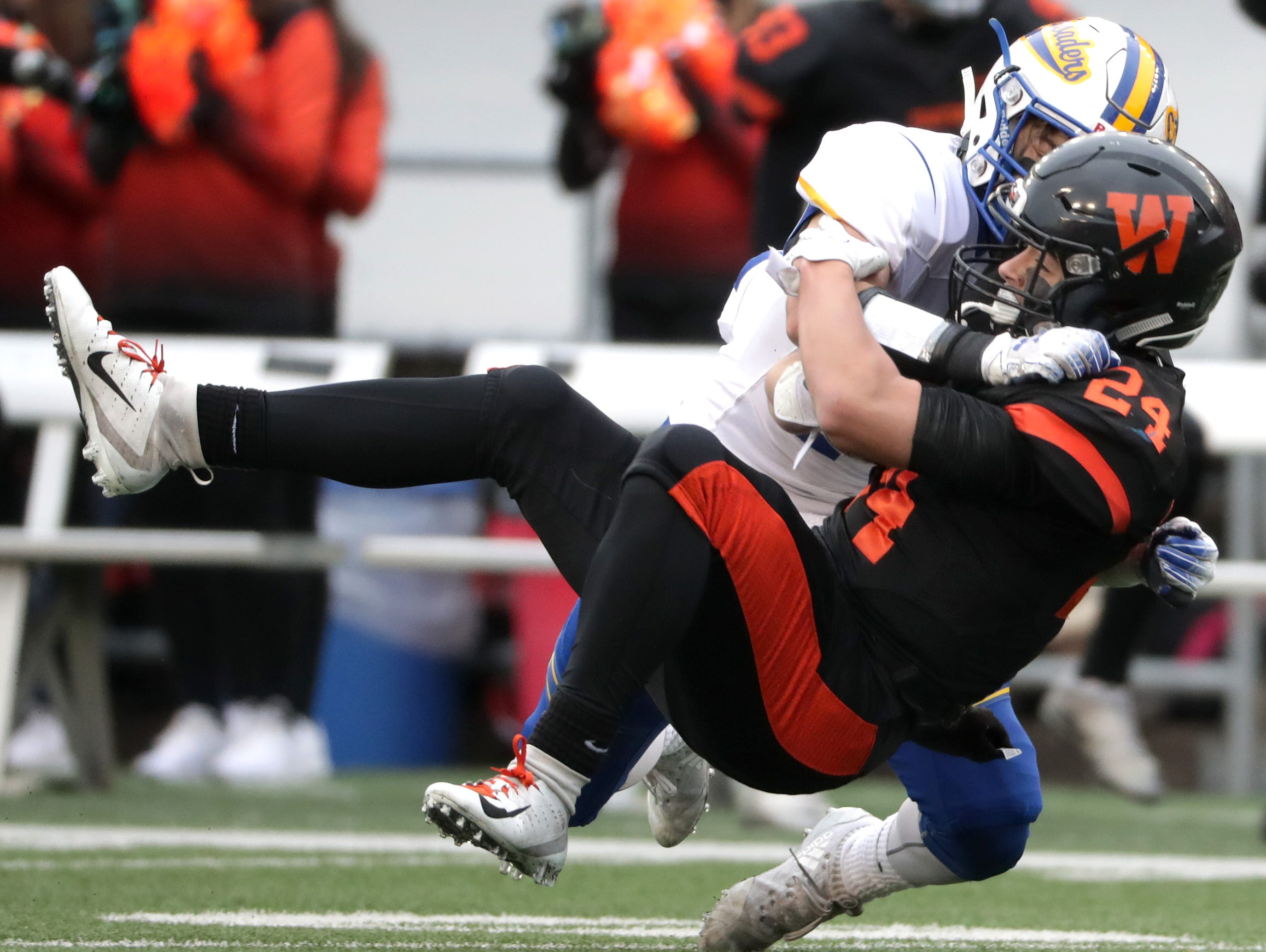 West De Pere High School's #24 Sam Mommaerts against Catholic Memorial High School's #24 Alex Oechsner during the WIAA Division  3 state championship football game on Friday, November 16, 2018, at Camp Randall in Madison, Wis. Wm. Glasheen/USA TODAY NETWORK-Wisconsin.