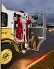 The Egg Harbor Fire Department provides a ride for Santa and Mrs. Claus to the Christmas tree lighting ceremony at a past Holly Days holiday celebration in the village.