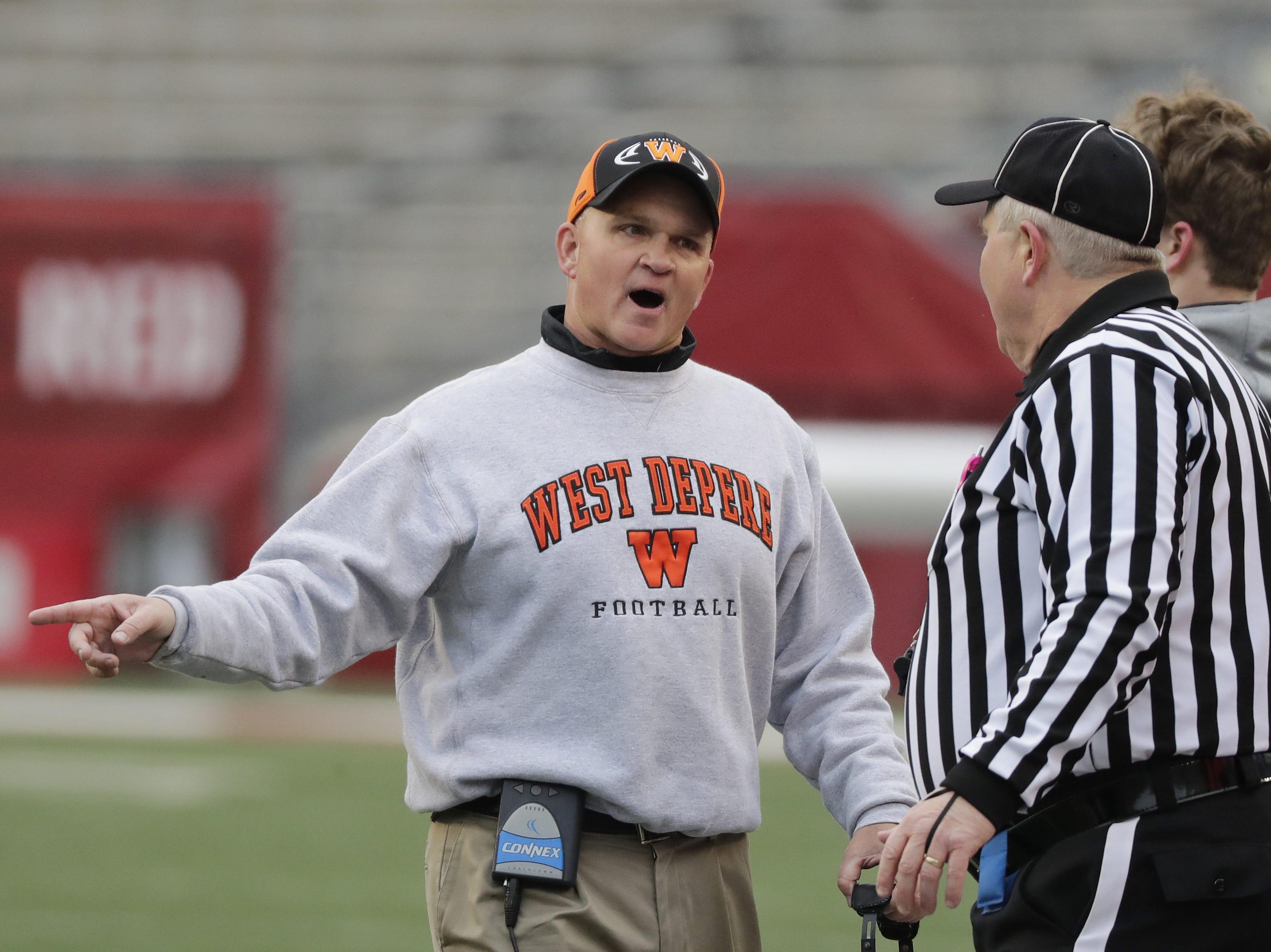 West De Pere's head coach Jack Batten talks to an official during the WIAA Division 3 championship game at Camp Randall Stadium on Friday, November 16, 2018 in Madison, Wis.