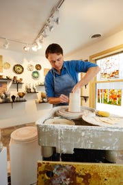 Porcelain artist Chad Luberger, shown at work, gives a demonstration of how he creates his work Friday at his Plum Bottom Pottery & Gallery. Painter Mary White will give a demonstration of her work Saturday.