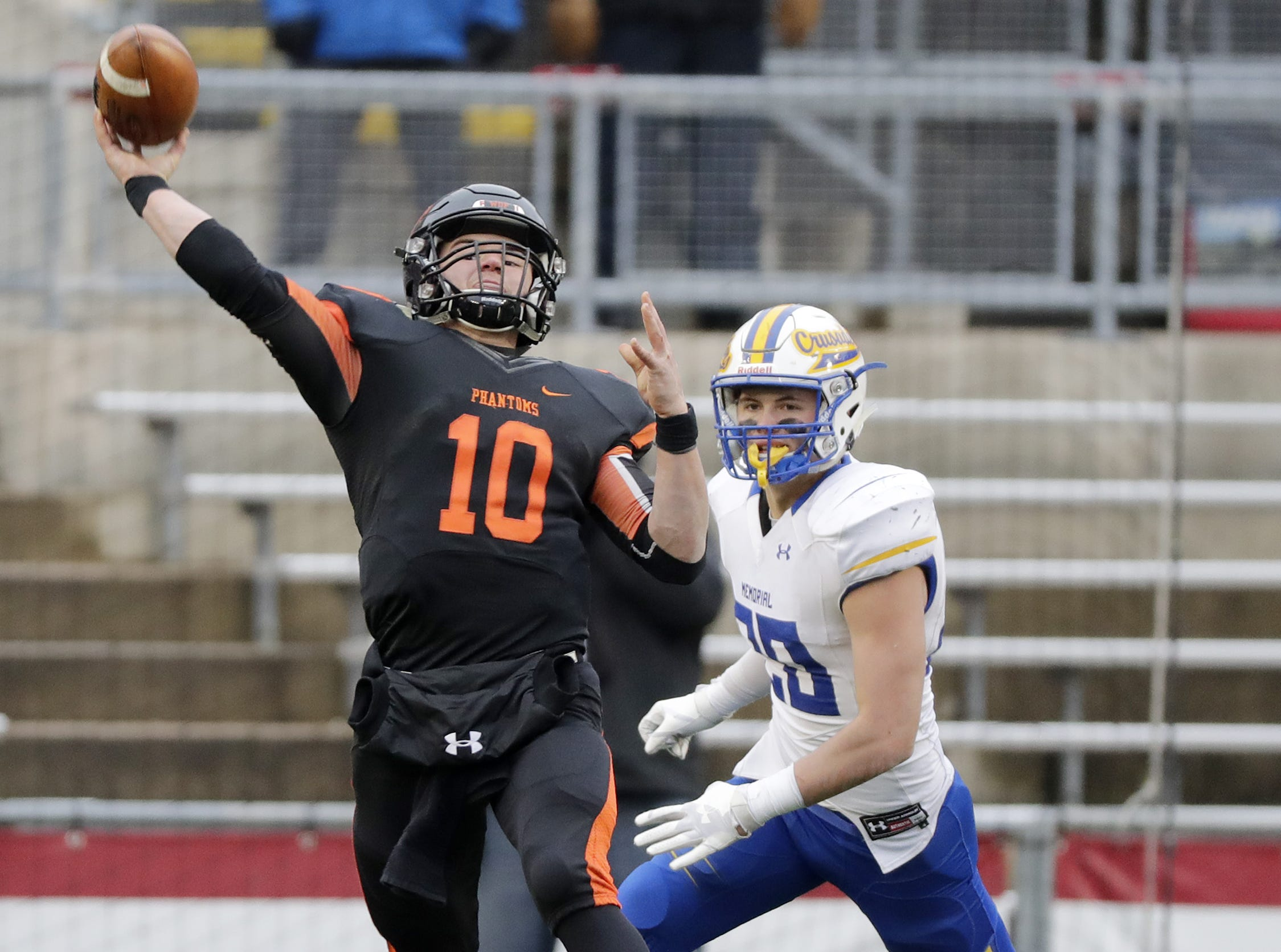 West De Pere's Josh Blount (10) throws under pressure in the fourth quarter against Catholic Memorial in the WIAA Division 3 championship game at Camp Randall Stadium on Friday, November 16, 2018 in Madison, Wis.