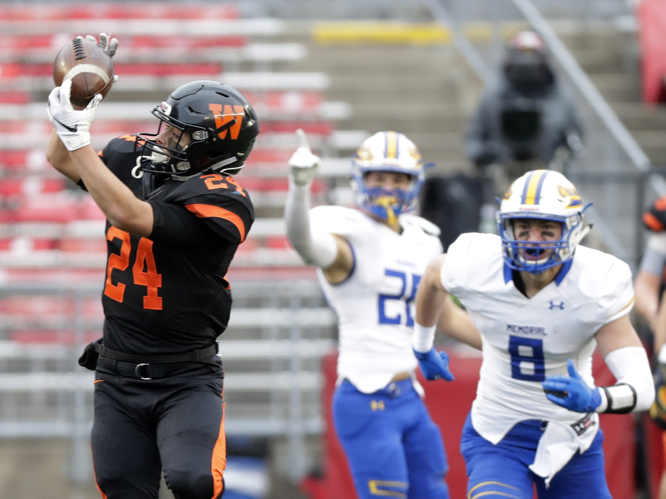 West De Pere's Sam Mommaerts (24) makes a catch against Catholic Memorial in the WIAA Division 3 championship game at Camp Randall Stadium on Friday, November 16, 2018 in Madison, Wis.