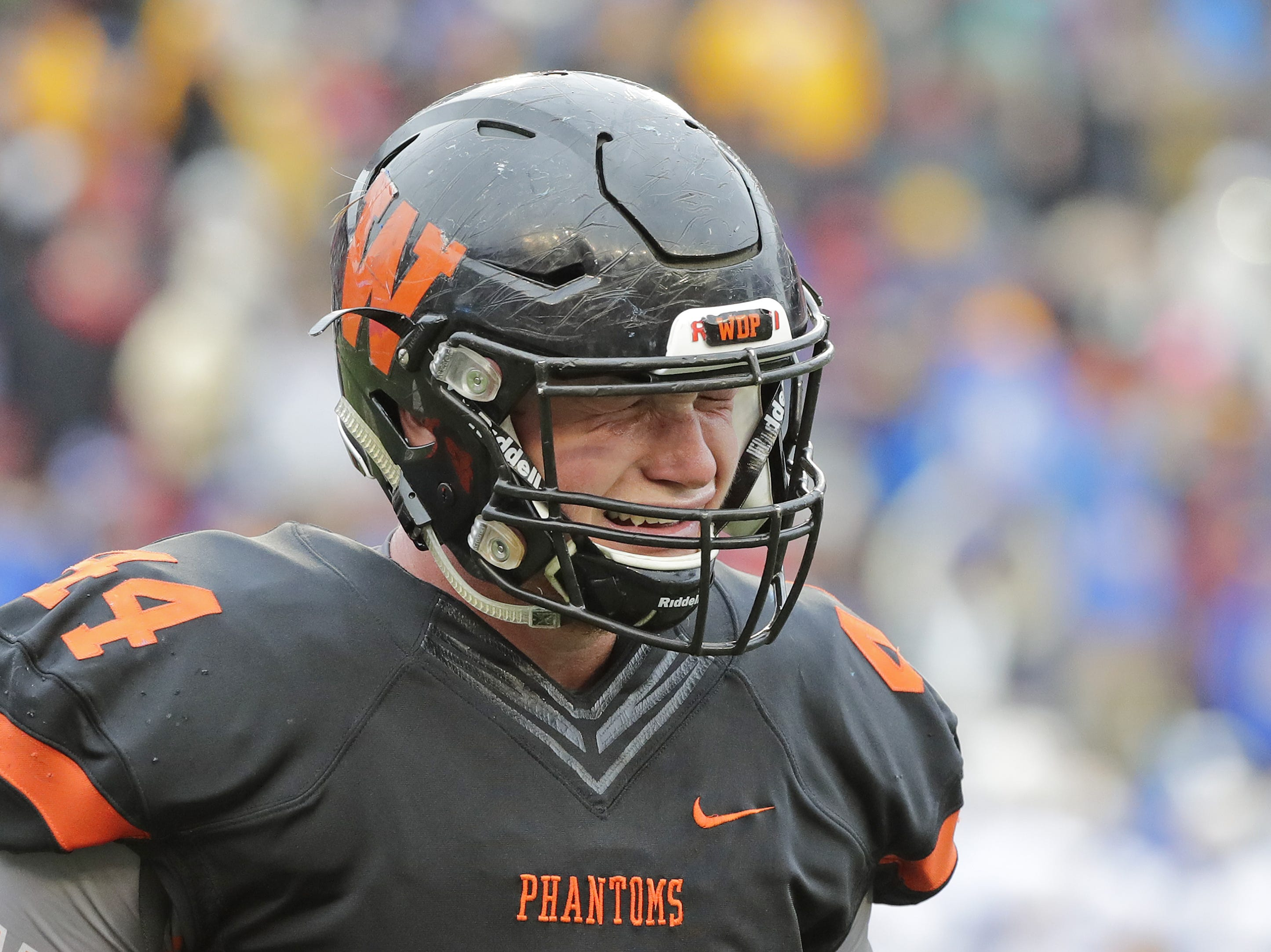 West De Pere's Jake Karchinski (44) walks off the field after the Phantoms lost to Catholic Memorial in the WIAA Division 3 championship game at Camp Randall Stadium on Friday, November 16, 2018 in Madison, Wis.
