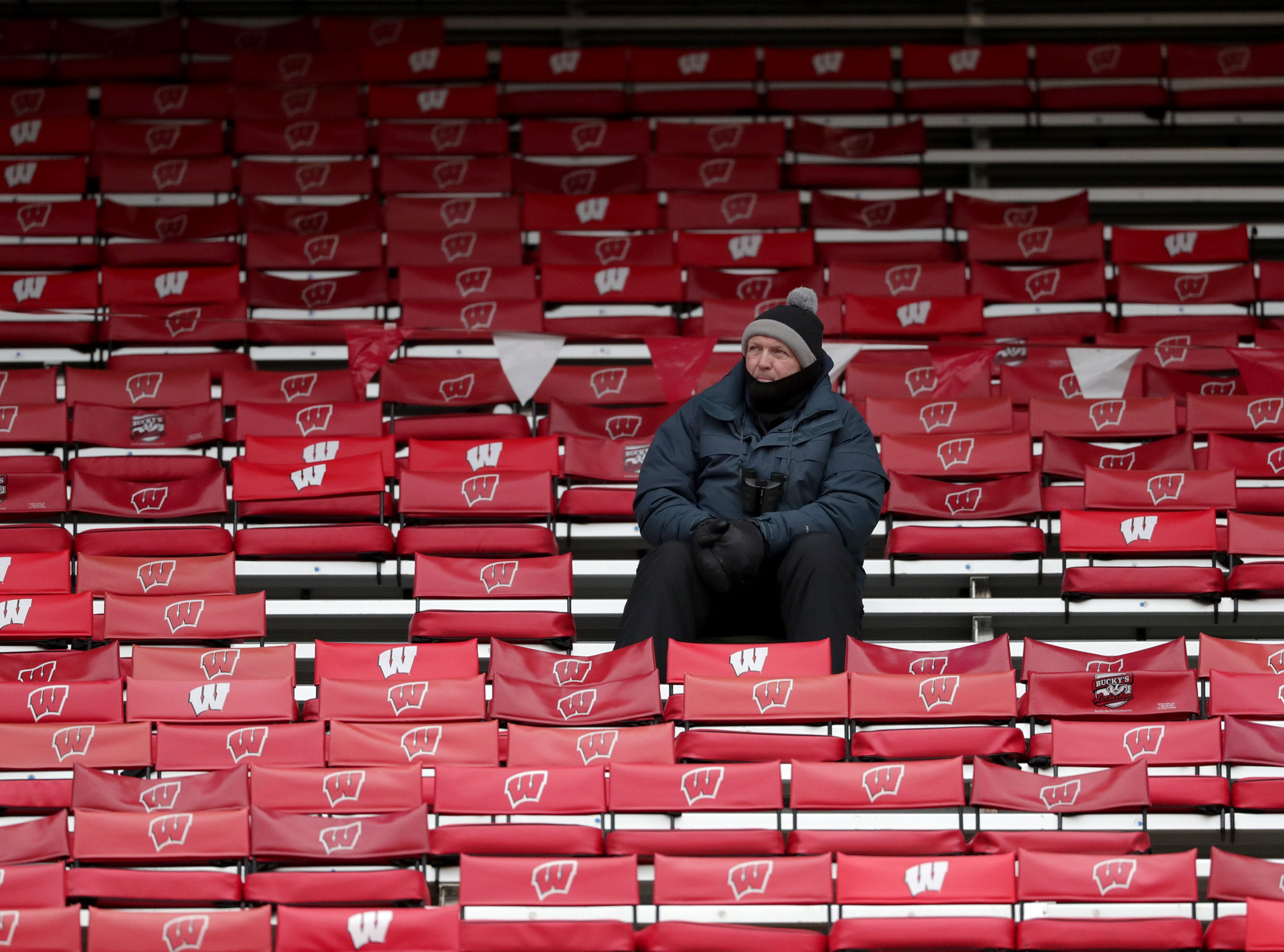 A lone fan watches West De Pere High School against Catholic Memorial High School during the WIAA Division  3 state championship football game on Friday, November 16, 2018, at Camp Randall in Madison, Wis. Wm. Glasheen/USA TODAY NETWORK-Wisconsin.