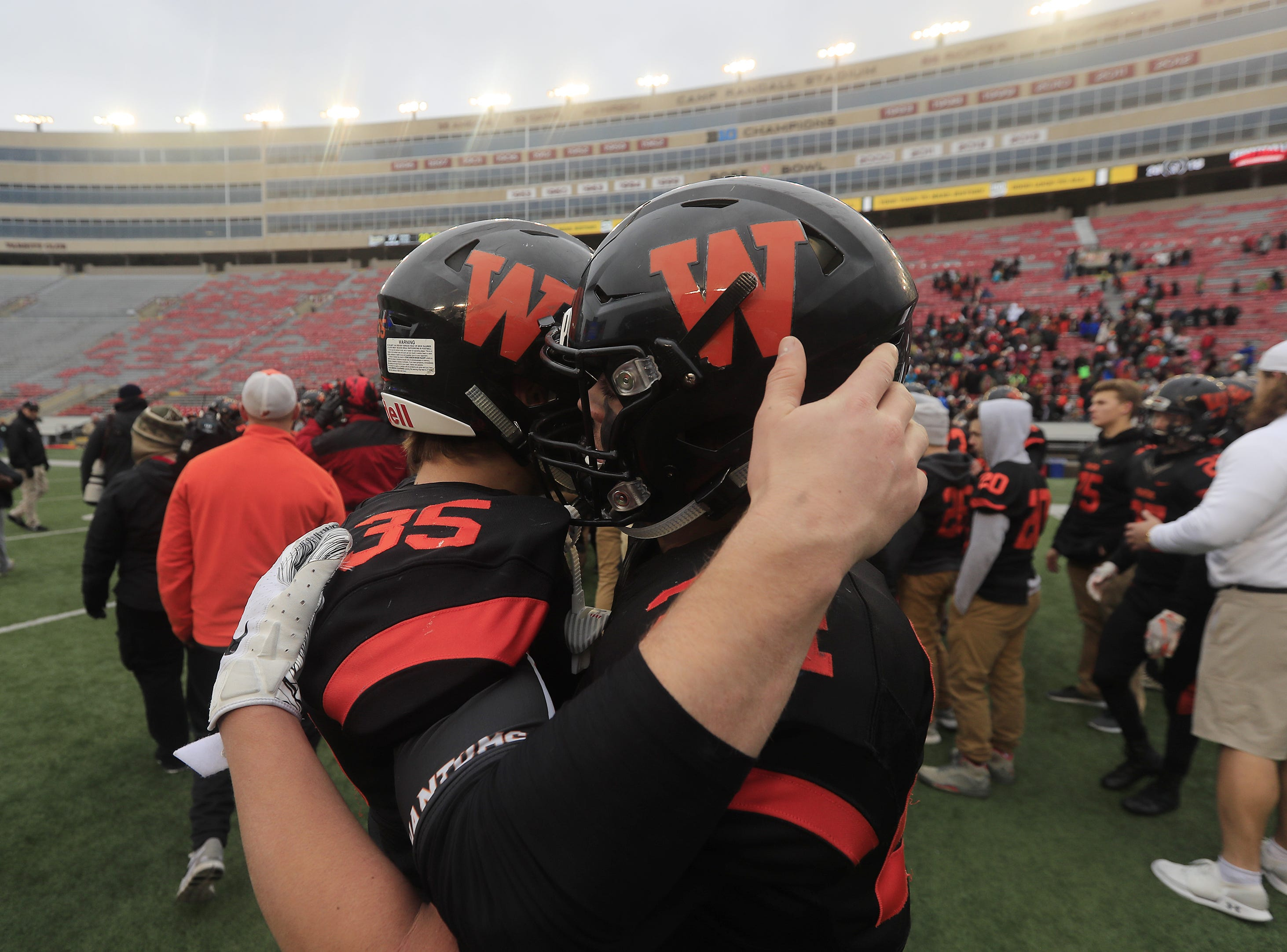 West De Pere's Alex Spitzer (35) and Sam Mommaerts (24) embrace after the Phantoms lost to Catholic Memorial in the WIAA Division 3 championship game at Camp Randall Stadium on Friday, November 16, 2018 in Madison, Wis.