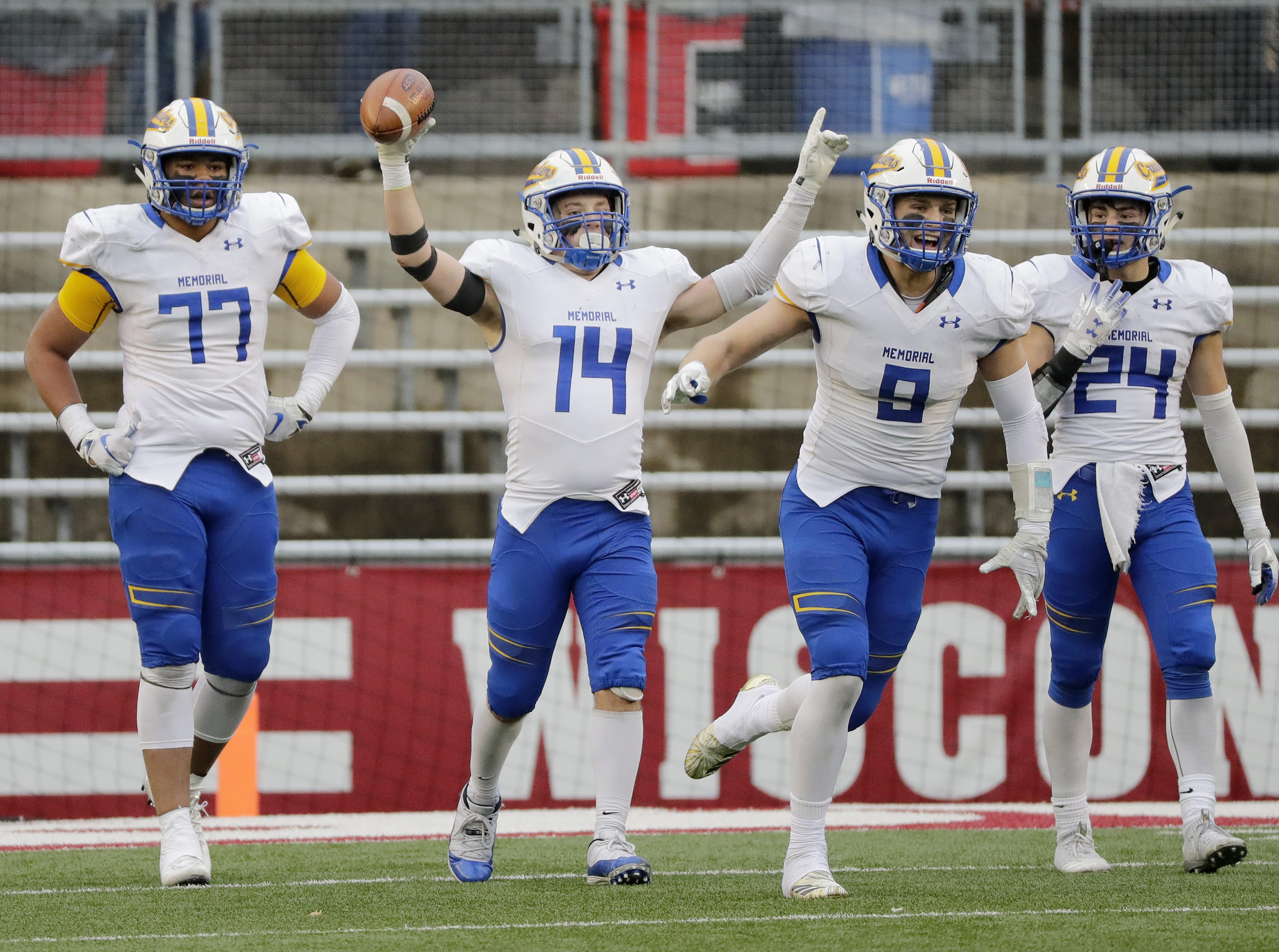 Catholic Memorial players celebrate after scoring a touchdown in the fourth quarter against West De Pere in the WIAA Division 3 championship game at Camp Randall Stadium on Friday, November 16, 2018 in Madison, Wis.