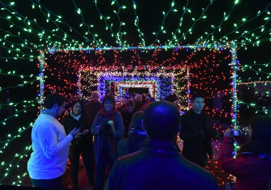"A walk-through tunnel of lights near the Sister Bay Christmas tree at Waterfront Park is part of the community's annual ""Capture The Spirit'' celebration."