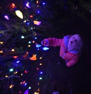 "Presley Madsen of Elmhurst, Illinois, seems mesmerized by the colorful lights on the Sister Bay commuinity Christmas tree following the lighting ceremony at last year's ""Capture The Spirit'' celebration."