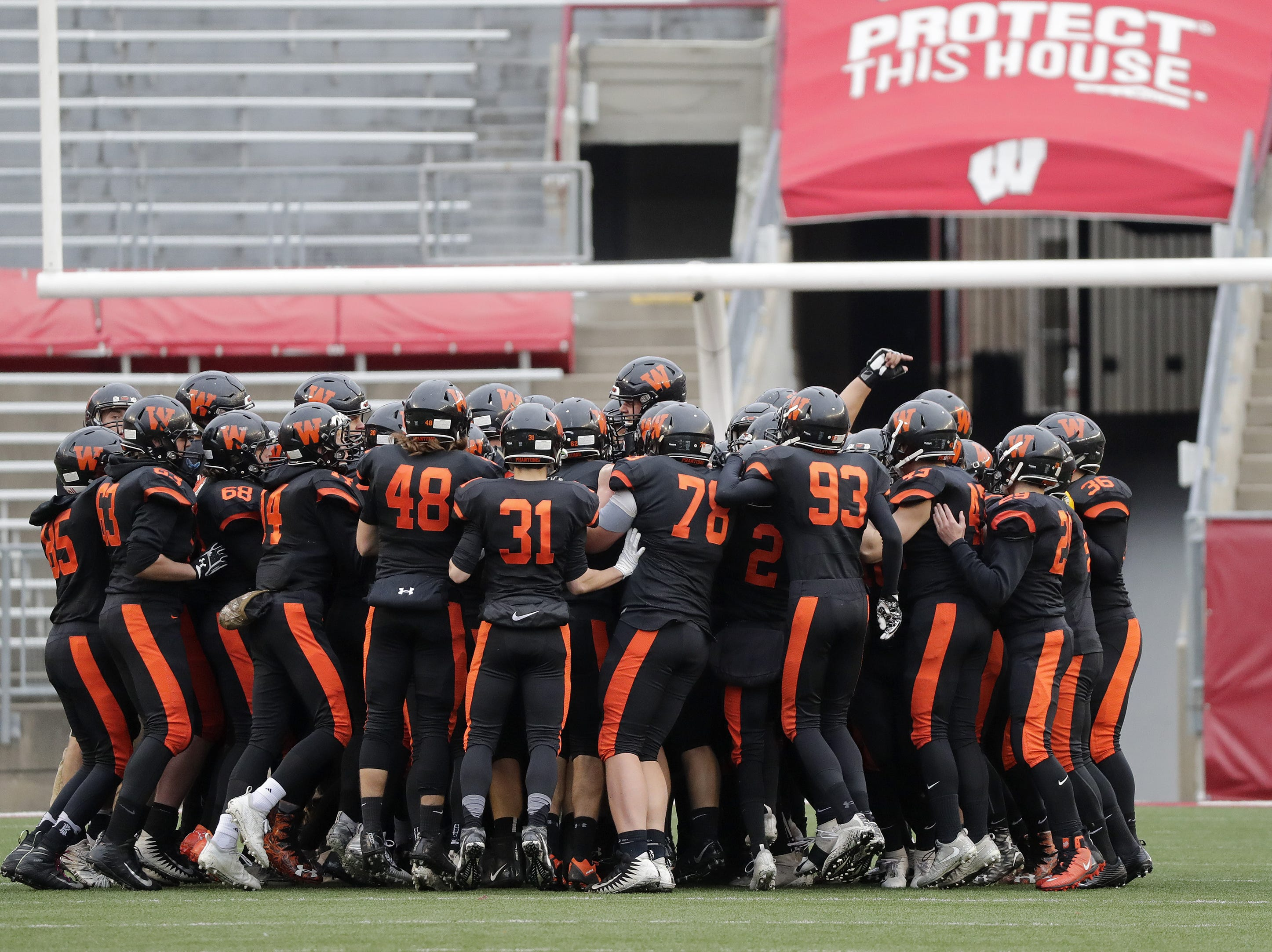 West De Pere take the field to face Catholic Memorial in the WIAA Division 3 championship game at Camp Randall Stadium on Friday, November 16, 2018 in Madison, Wis.