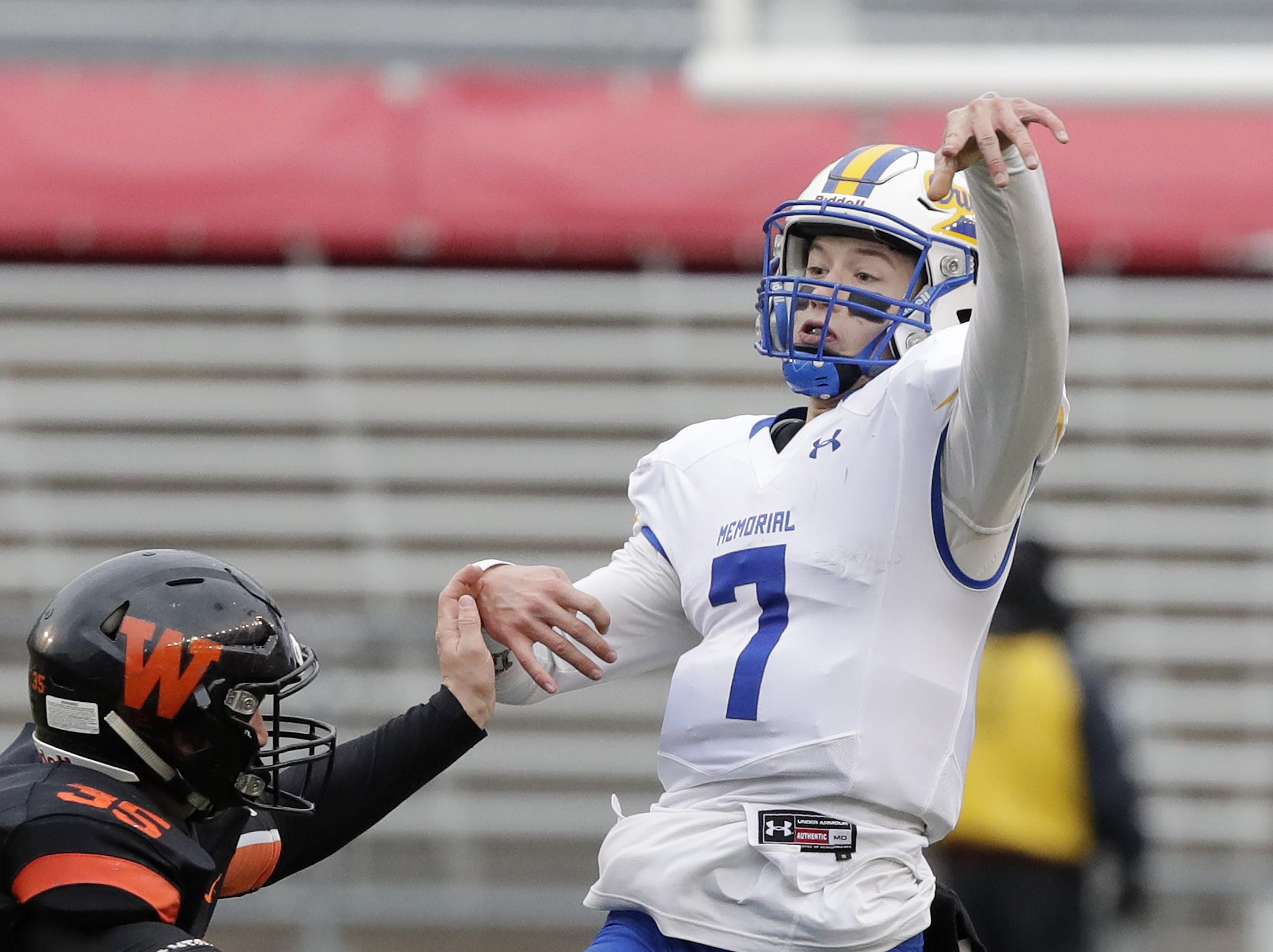 West De Pere's Alex Spitzer (35) pressures Catholic Memorial quarterback Luke Fox (7) in the WIAA Division 3 championship game at Camp Randall Stadium on Friday, November 16, 2018 in Madison, Wis.
