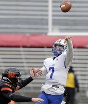 West De Pere's Alex Spitzer (35) pressures Catholic Memorial quarterback Luke Fox (7) in the WIAA Division 3 championship game Friday at Camp Randall Stadium in Madison.