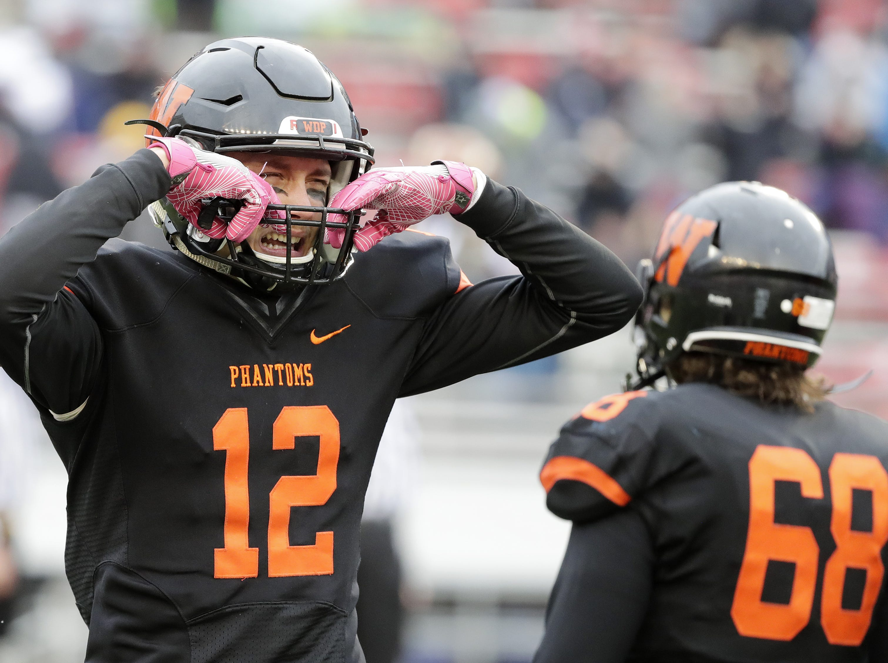 West De Pere's John Edinger (12) walks off the field after the Phantoms lost to Catholic Memorial in the WIAA Division 3 championship game at Camp Randall Stadium on Friday, November 16, 2018 in Madison, Wis.