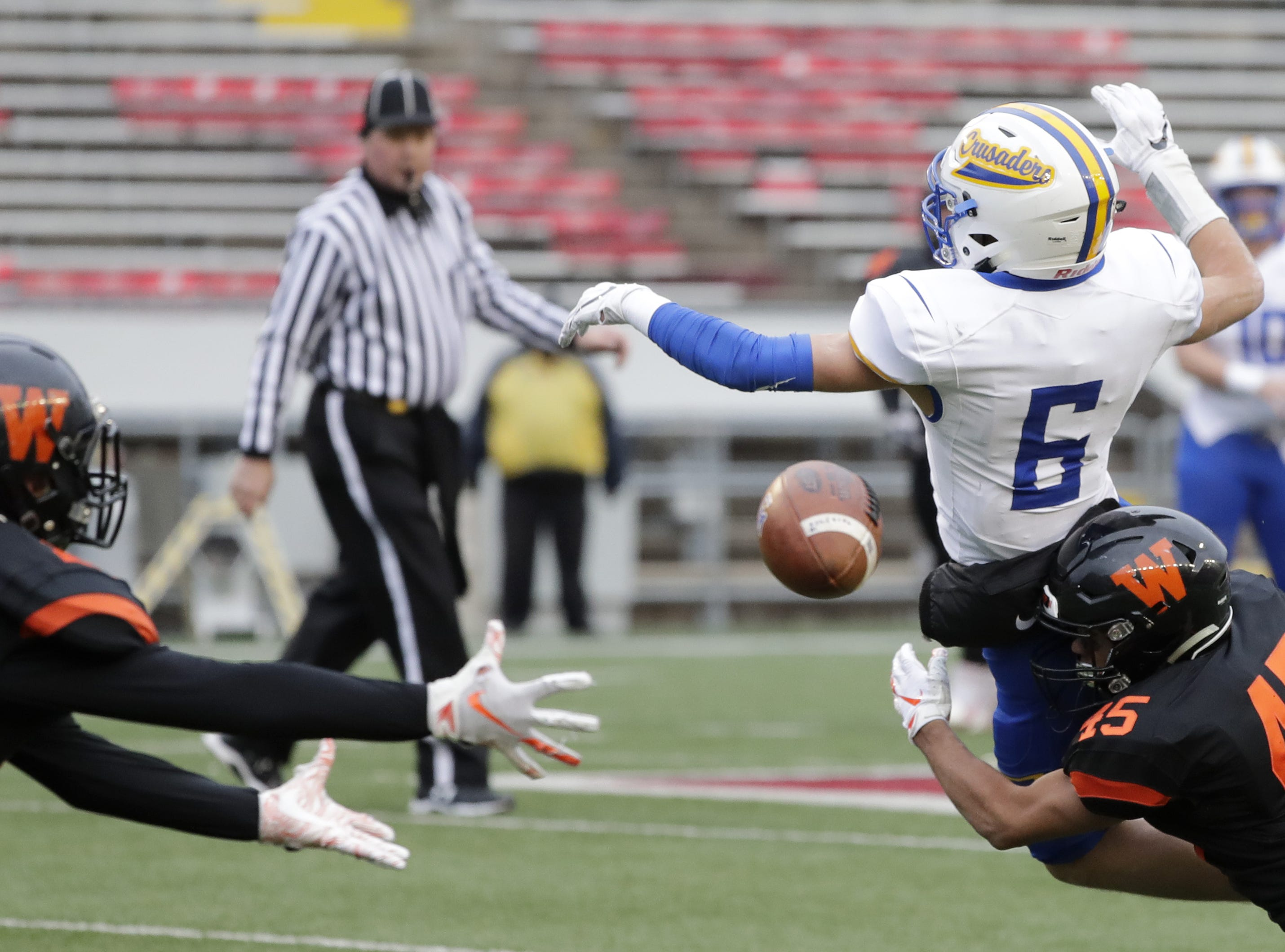 West De Pere's Isiah Burdette (45) defends a pass intended for Catholic Memorial's Joe Sikma (6) in the WIAA Division 3 championship game at Camp Randall Stadium on Friday, November 16, 2018 in Madison, Wis.