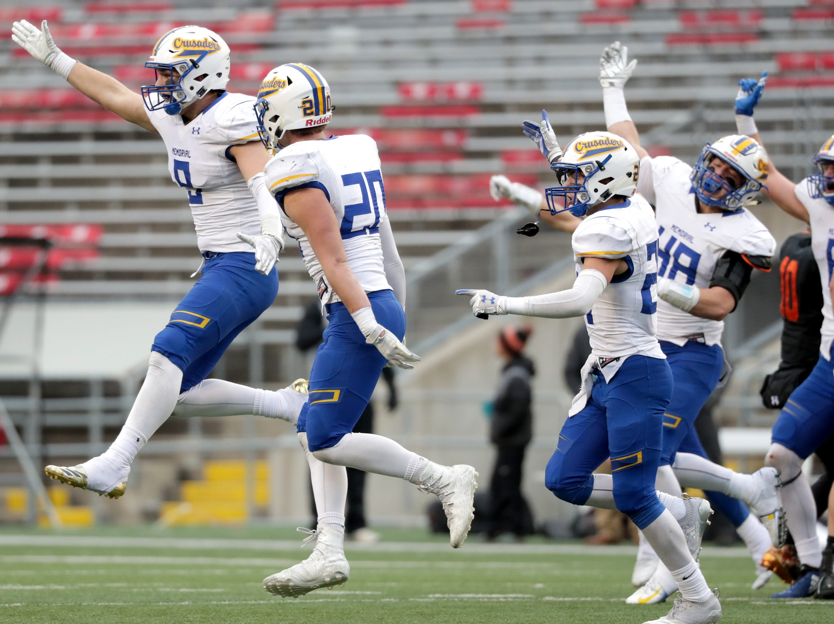 Catholic Memorial High School  players celebrate a fumble recovery in the second half against West De Pere High School during the WIAA Division  3 state championship football game on Friday, November 16, 2018, at Camp Randall in Madison, Wis. Wm. Glasheen/USA TODAY NETWORK-Wisconsin.