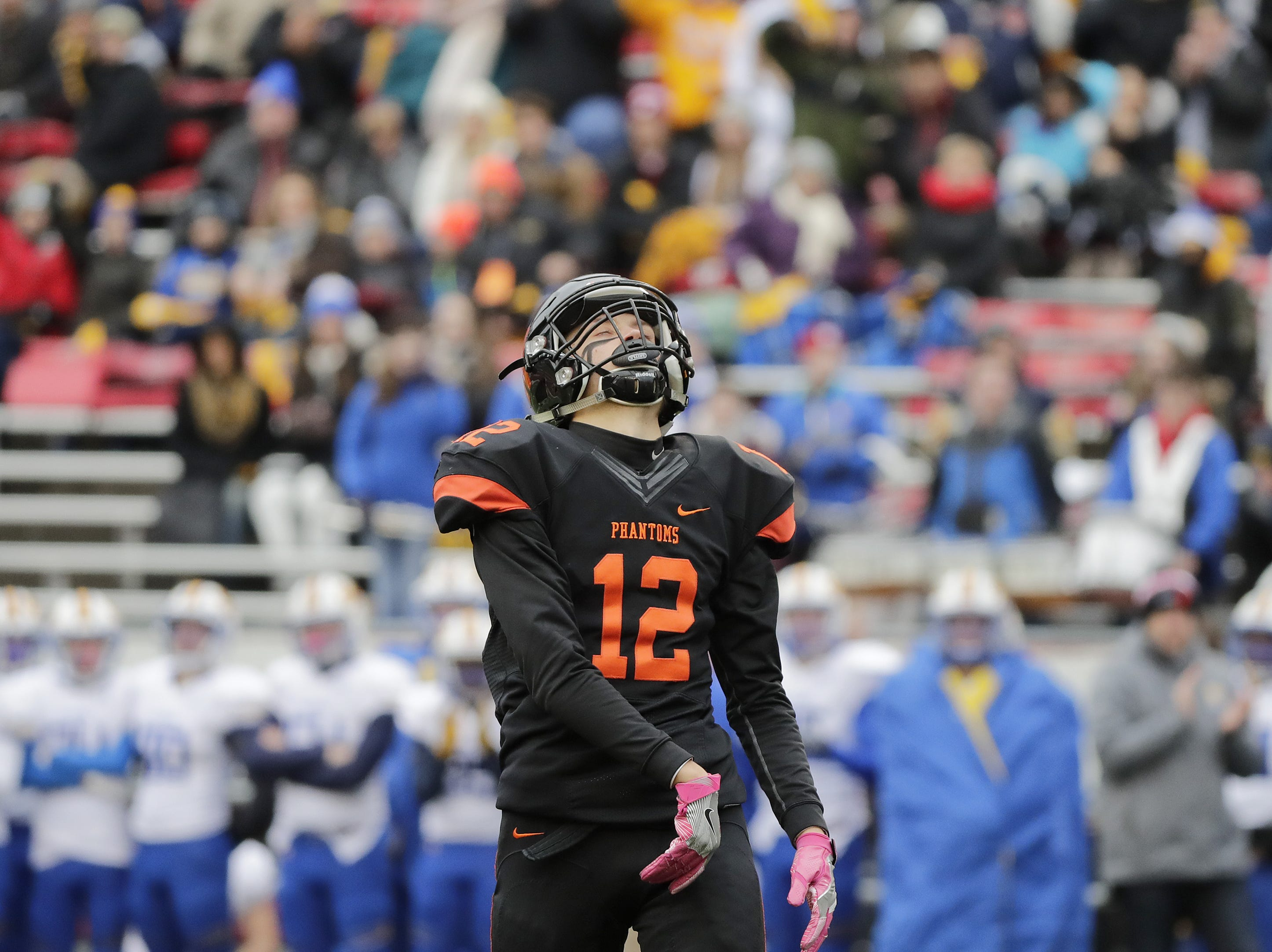 West De Pere's John Edinger (12) reacts after being flagged for pass interference against Catholic Memorial in the WIAA Division 3 championship game at Camp Randall Stadium on Friday, November 16, 2018 in Madison, Wis.