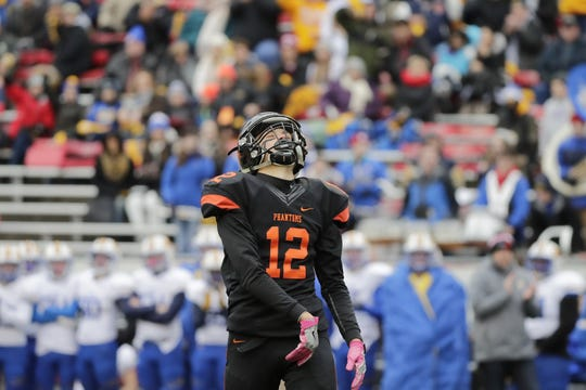 West De Pere's John Edinger (12) reacts after being flagged for pass interference against Catholic Memorial in the WIAA Division 3 championship game Friday at Camp Randall Stadium in Madison.