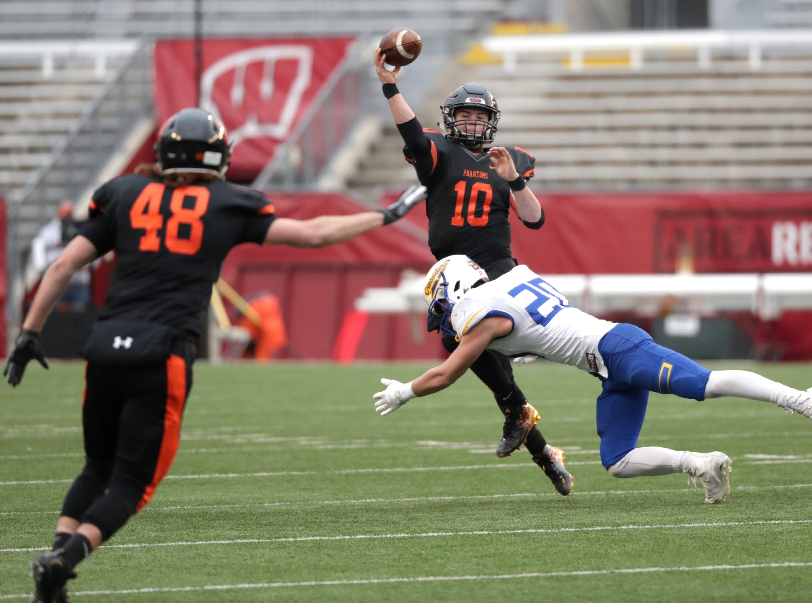 West De Pere High School's #10 Josh blount throws under pressure from Catholic Memorial High School's #20 Joey Goetz during the WIAA Division  3 state championship football game on Friday, November 16, 2018, at Camp Randall in Madison, Wis. Wm. Glasheen/USA TODAY NETWORK-Wisconsin.
