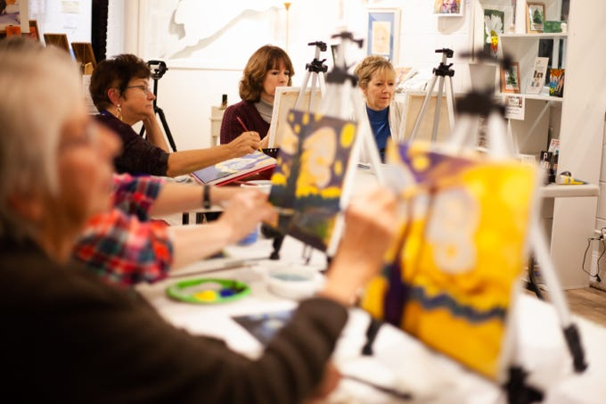 "Patty Cunningham, Ellisa Culp, and Rebecca Signmund (left to right)  add details to their renditions of  Van Gogh's Starry Night at the  ""Ladies Night"" at The White Rabbit Art Gallery in Travelers Rest on November 15th 2018."