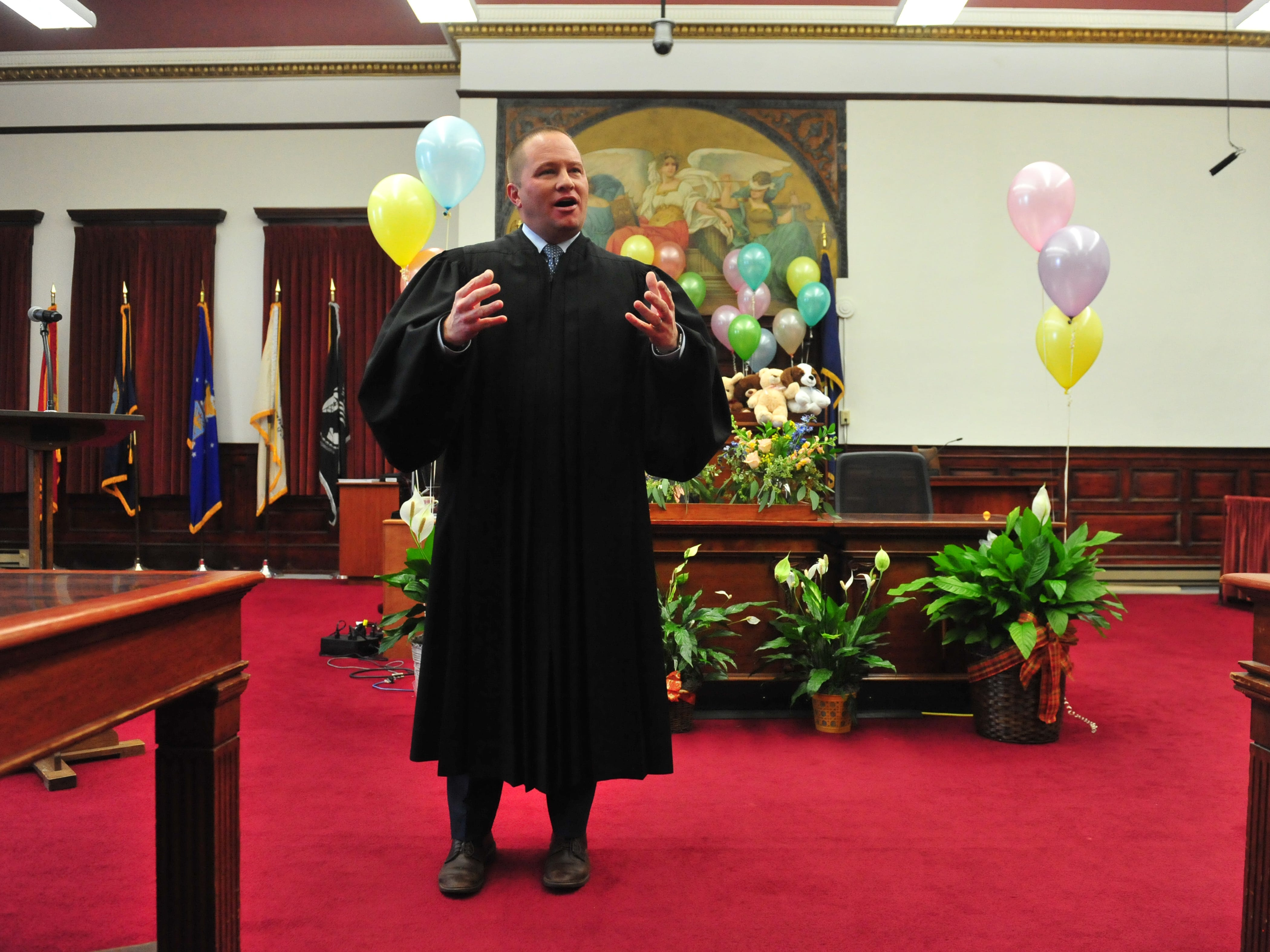 Judge Greg Pinski makes opening remarks during the Great Falls Adoption Day celebration on Friday in the Cascade County Courthouse.